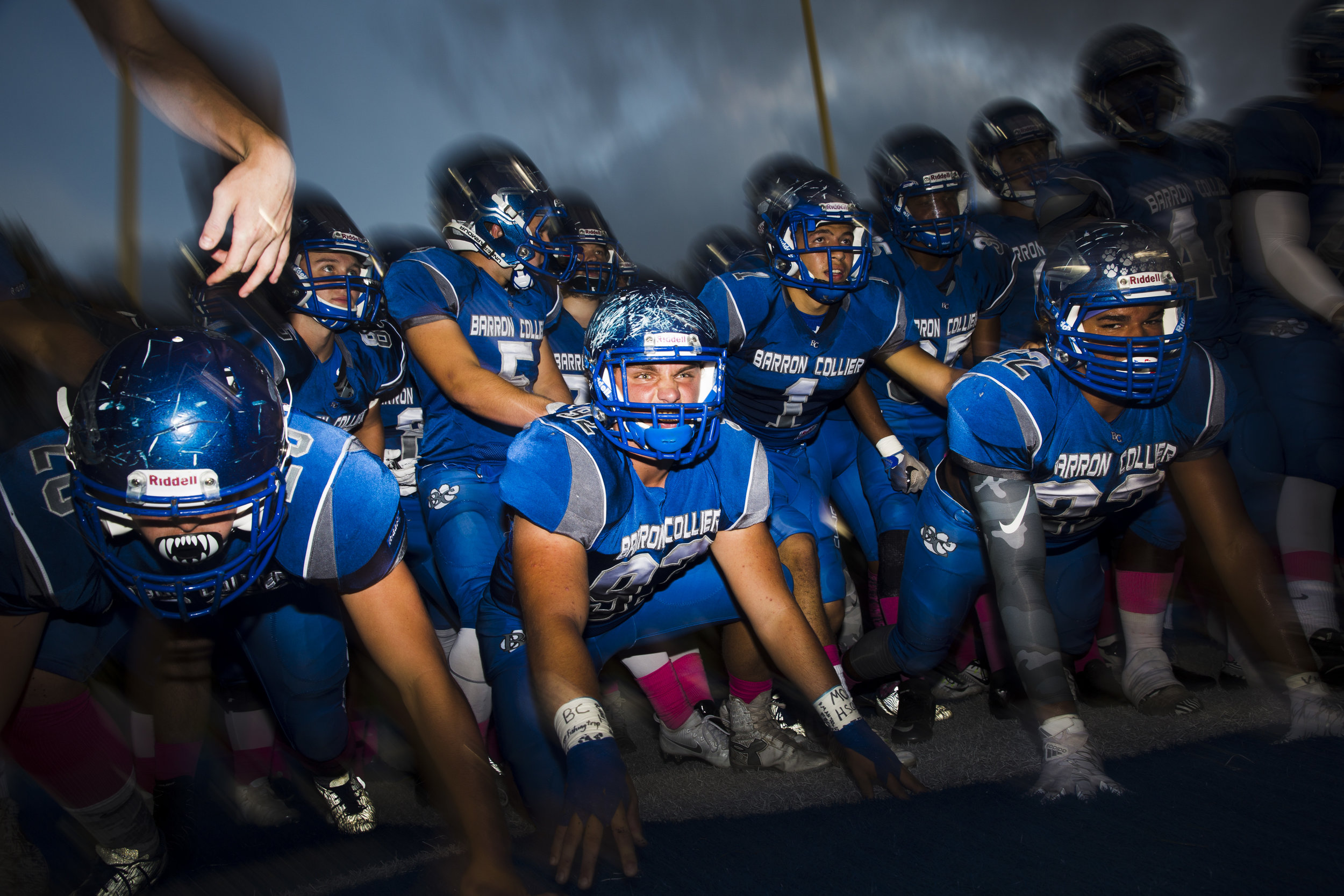 The Barron Collier Football team gets pumped up right before taking the field against Gulf Coast High School Friday, October 7, 2016 on their home field in Naples, Fla.