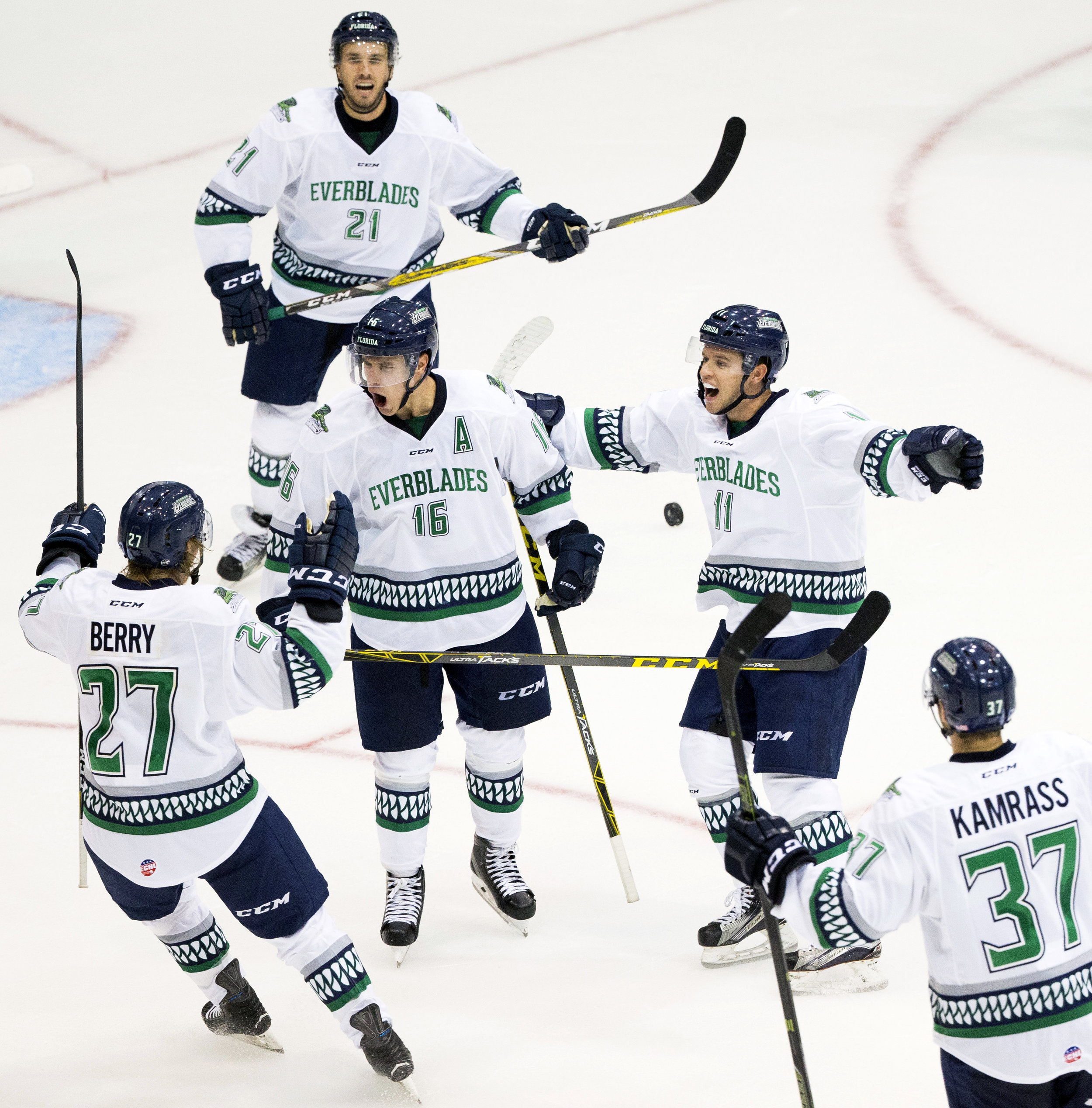 Florida Everblades' players celebrate with Mike Aviani (16) after Aviani scored the game-tying goal with 59 seconds left in the third period of action at Germain Arena Friday, October 14, 2016 in Estero, Fla. The Everblades would score all of their three goals in the final three minutes of regulation defeating the Greenville Swamp Rabbits 3-2 in their first game of the season.