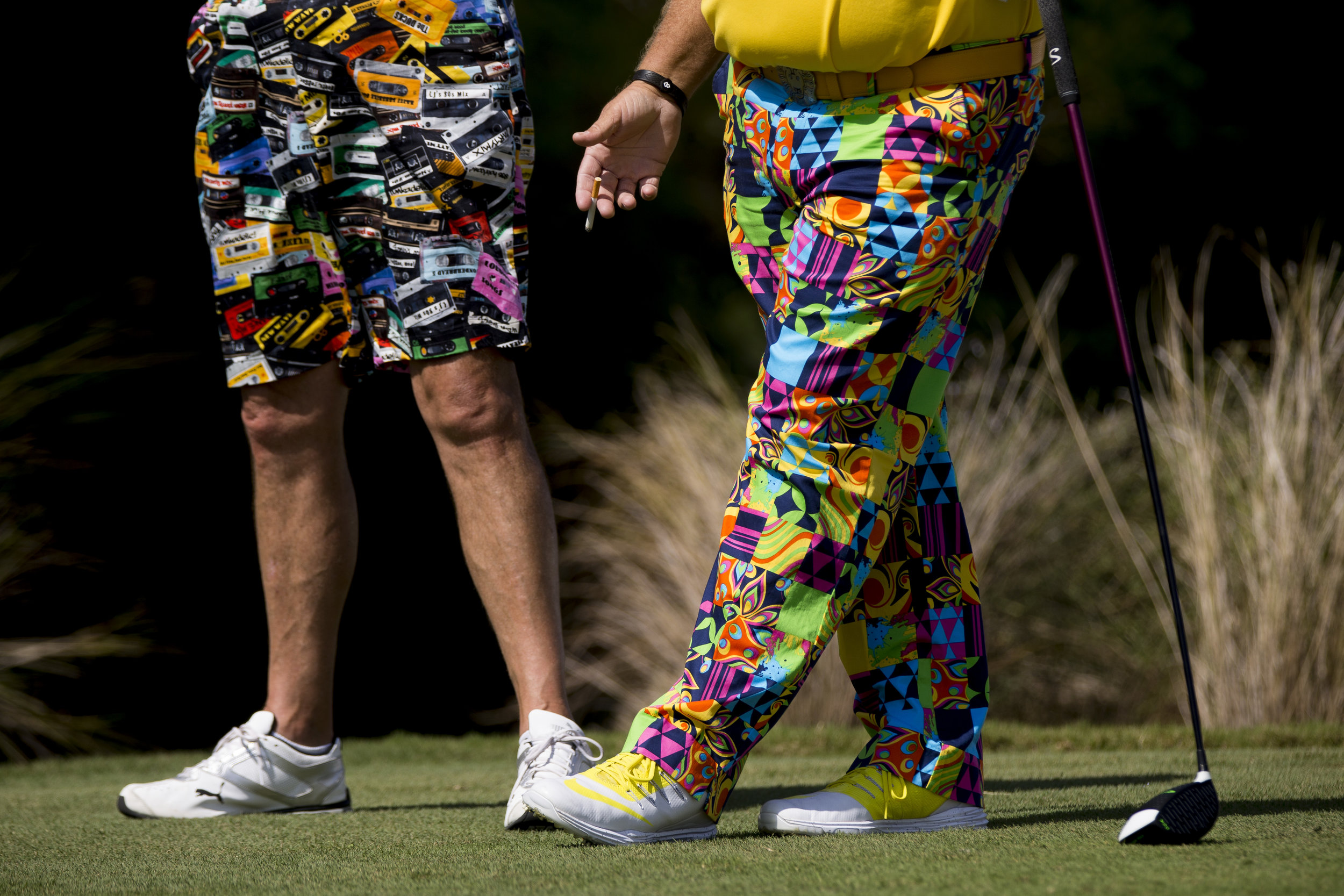 PGA Tour Pro John Daly, right, smokes a cigarette as he speaks with his caddy prior to teeing off during the Chubb Classic Pro-Am at TwinEagles Club Wednesday, Feb. 15, 2017 in Naples, Fla.