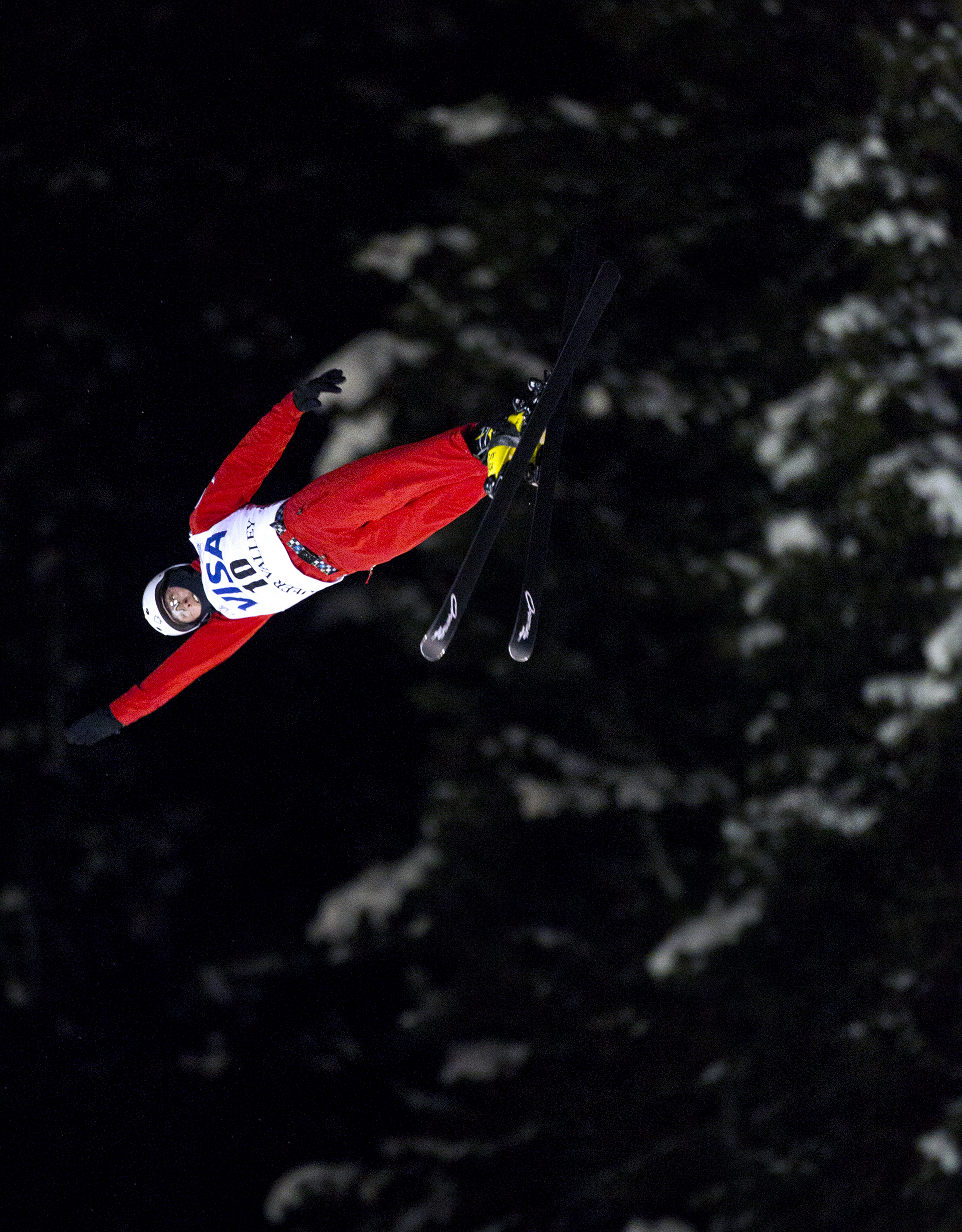 Petr Medulich of Russia extends his arm during his second and final jump in the men's finals of the Visa Freestyle International Aerials World Cup at Deer Valley Resort Friday, Feb. 5, 2016 in Park City, Utah. The jump registered a score of 128.05 with the judges and would solidify Medulich first place in the event and would propel him to first overall in the world.