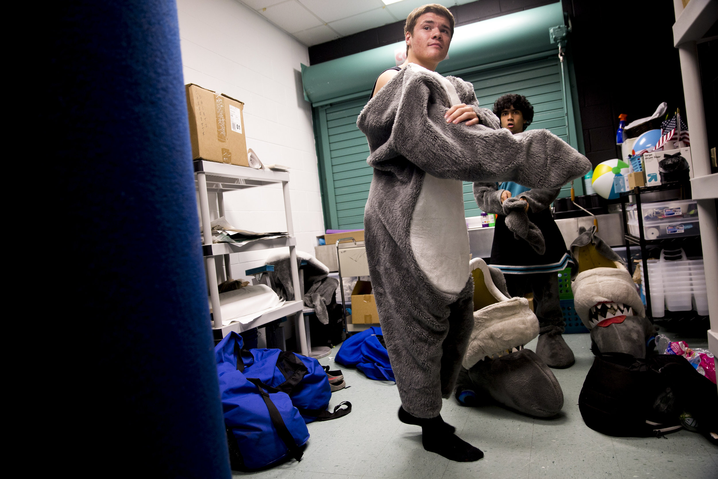 Gulf Coast High School juniors Dylan Spelman, 16, left, and Matthew Masin, 17, adorn the costumes for the school's mascots Sharkey and Sharkette, respectively, prior to a football game against Hialeah High School Friday, September 2, 2016 at Gulf Coast High School in Naples. The two have embraced the role since last year's homecoming game and have brought a new energy and commitment to the school's icon.