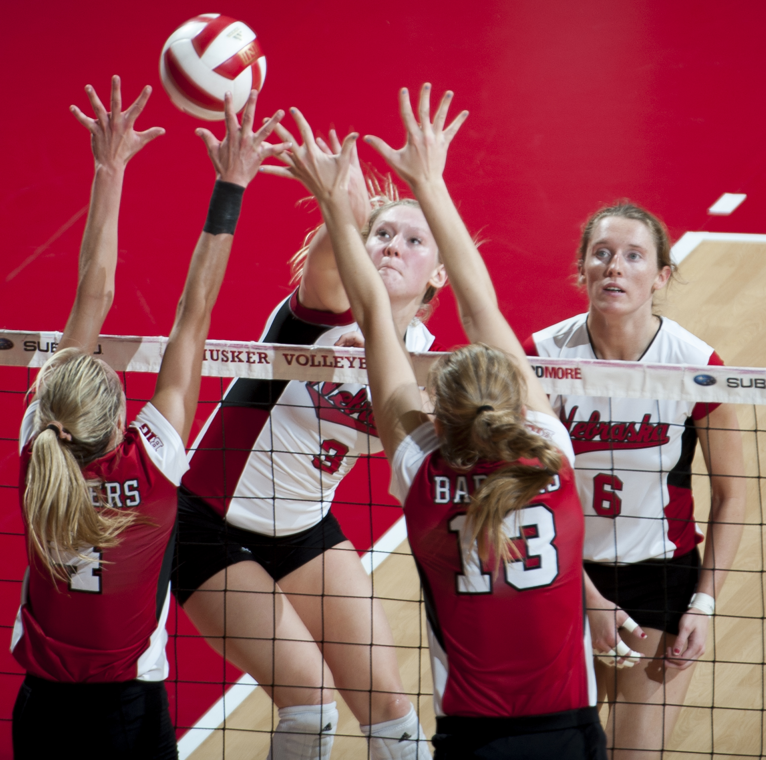 Nebraska's Kelly Hunter (3) spikes the ball against Wisconsin's Kelli Bates (4) and Haleigh Nelson (13) in the fourth set of action at Devaney Sports Center in Lincoln Saturday Oct. 24, 2015. The Huskers would win the first set of the match but then lose three straight. Losing the match three sets to one.