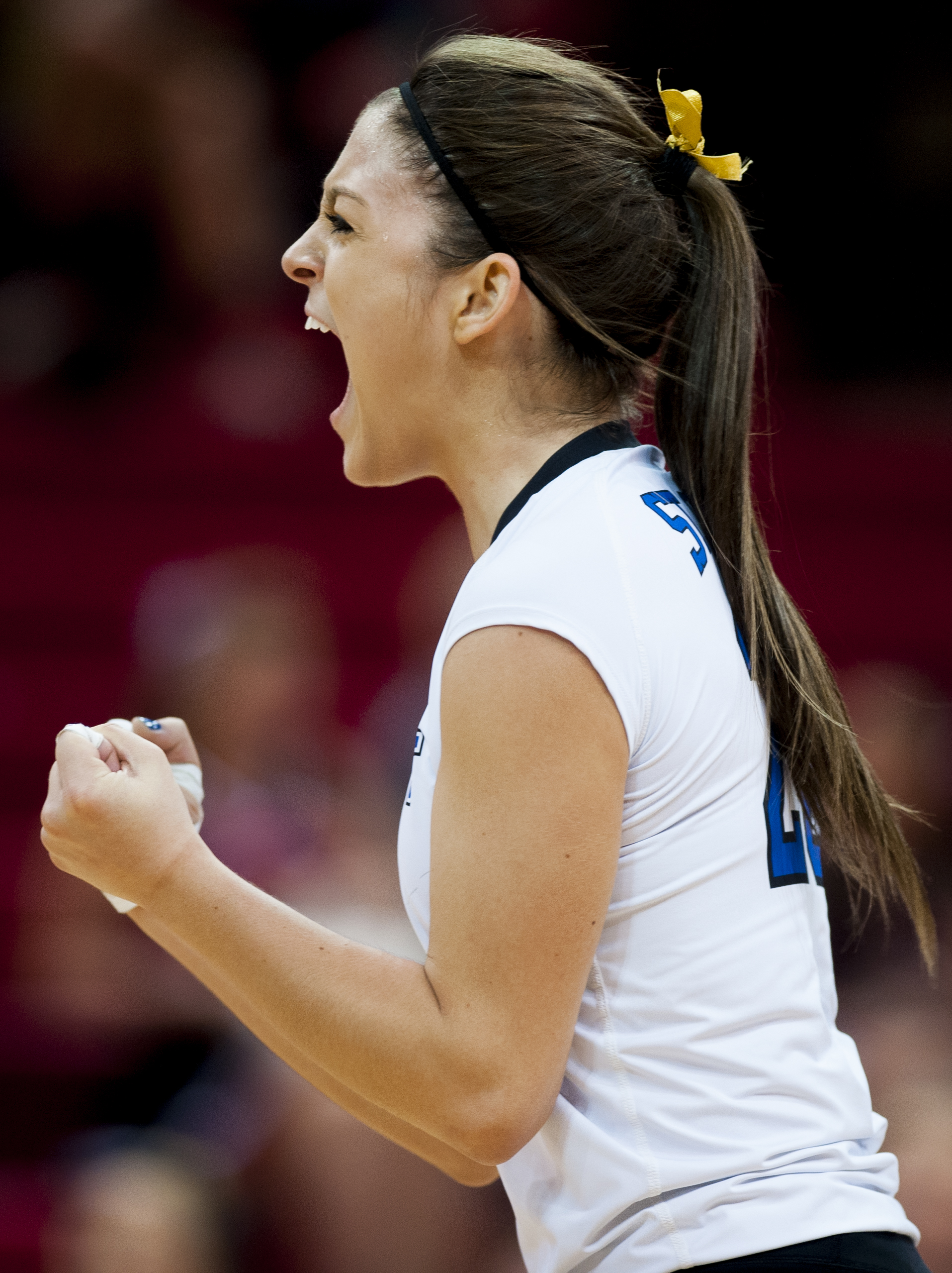 St. Cecilia's Shandra Farmer gets pumped after scoring a point against Stanton during the first set in the Class C-2 Championship game in Devaney Sports Center Saturday, November 14, 2015 in Lincoln, Nebraska.