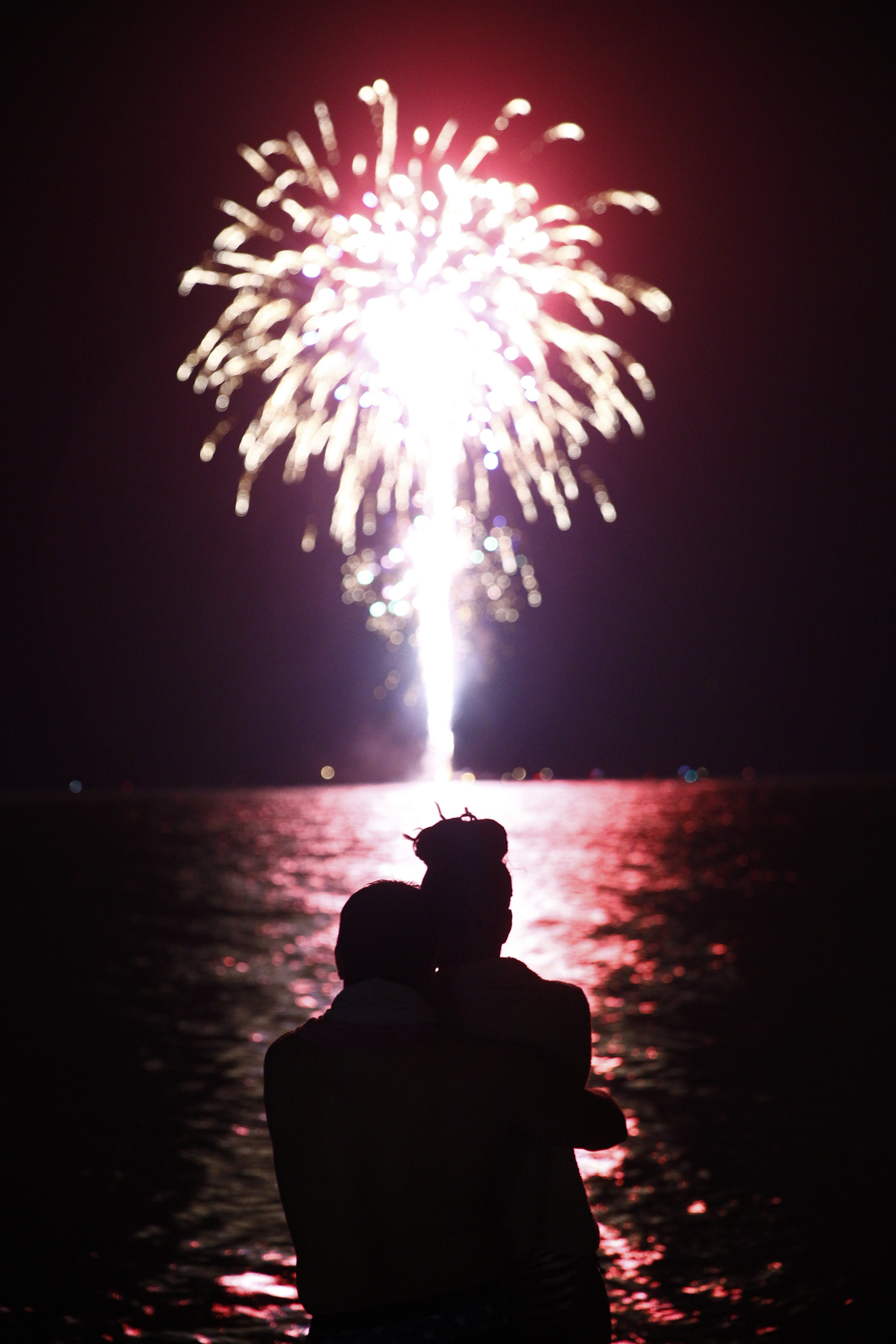 """Luis Lorenzo and his wife Aloima, both of Naples, embrace as they watch the fireworks off of Naples Beach Monday, July 4, 2016. This will be a day the couple will soon not forget. Originally from Cuba, Luis gained his United States citizenship February 26, 2016. """"For me this a great experience,"""" Luis said. """"We're here baby!"""""""