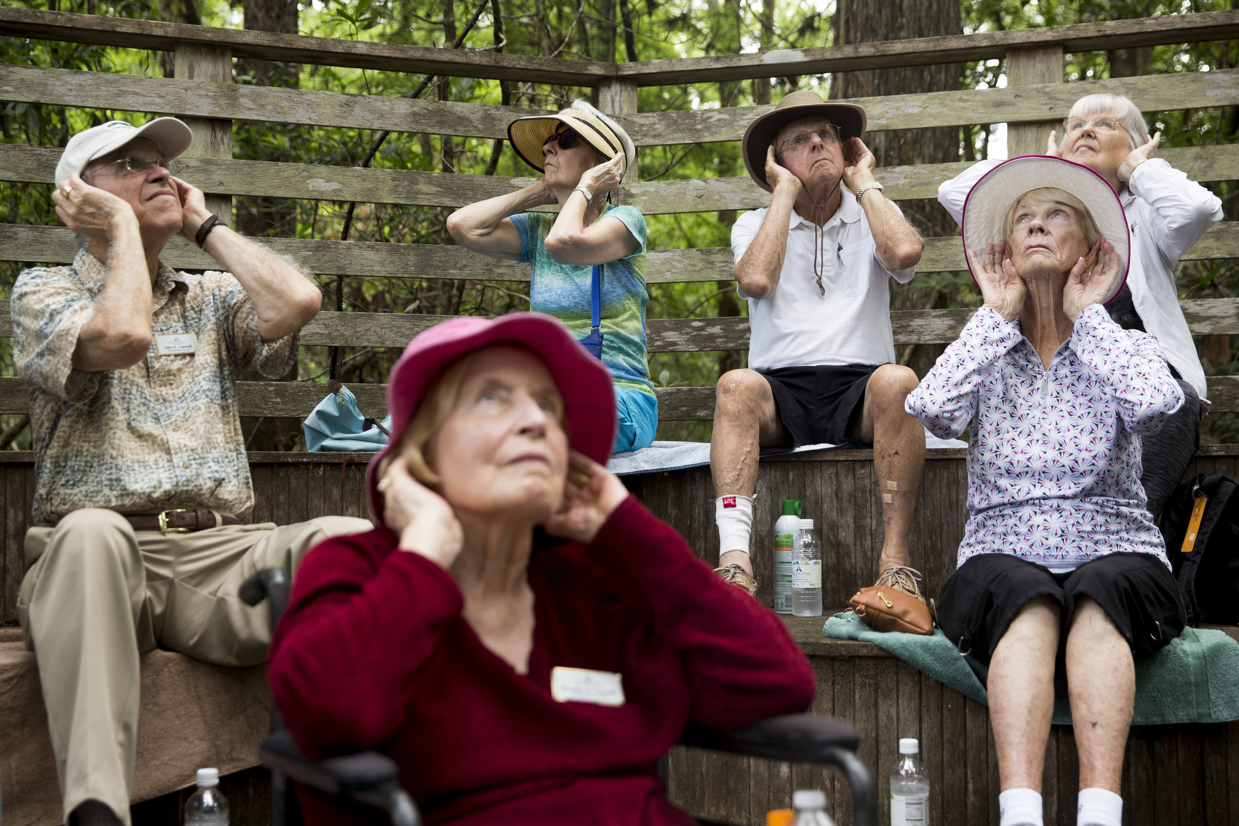 In honor of National Senior Health and Fitness Day residents of The Arlington, in a moment of silence, cup their ears to take in the many sounds of the swamp during a guided tour of Audubon Corkscrew Swamp Sanctuary Wednesday, May 31, 2017 in Naples.