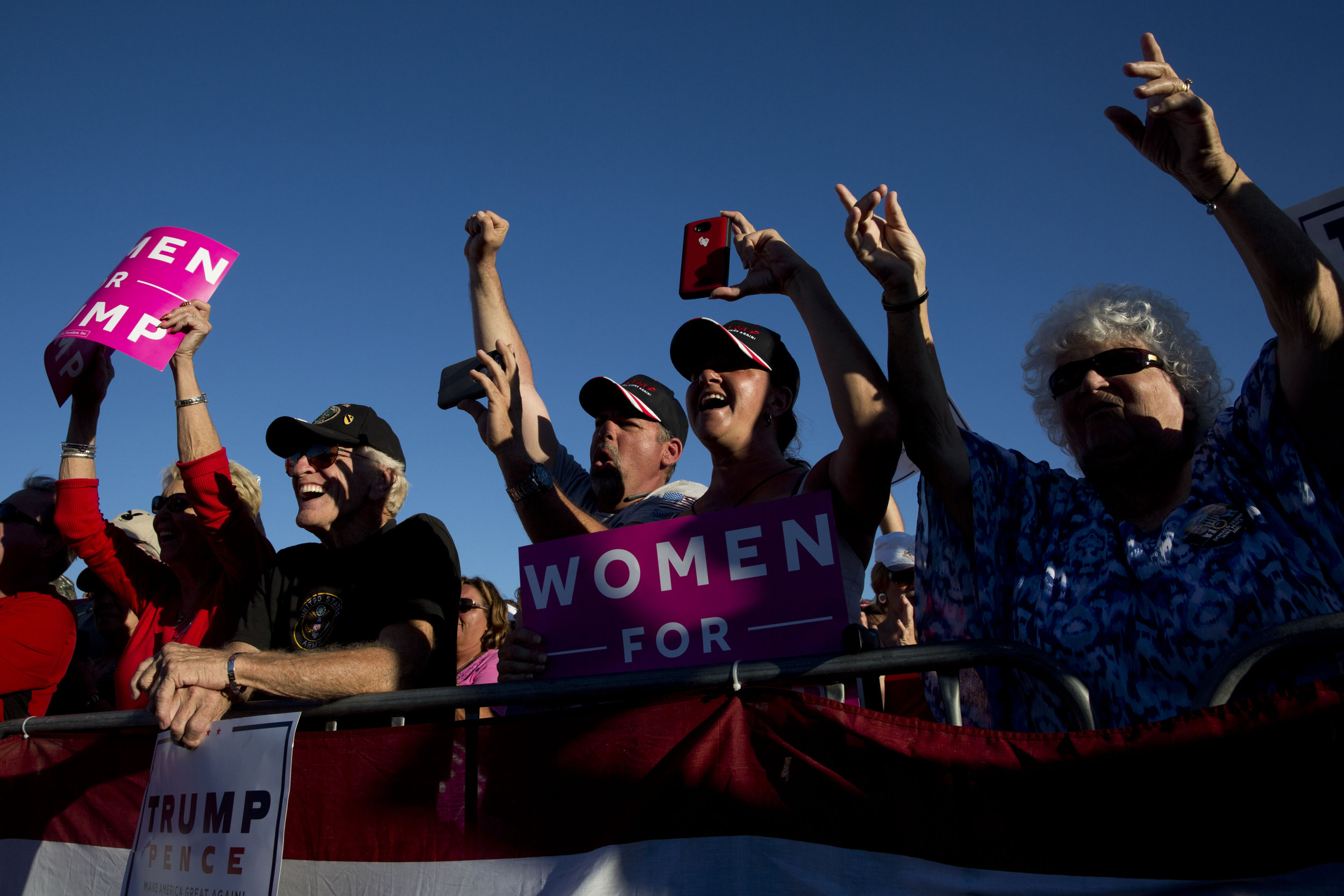 Donald Trump supporters cheer as Republican presidential candidate Donald Trump takes to the stage during his rally at the Collier County Fairgrounds Sunday, October 23, 2016 in Golden Gate Estates.
