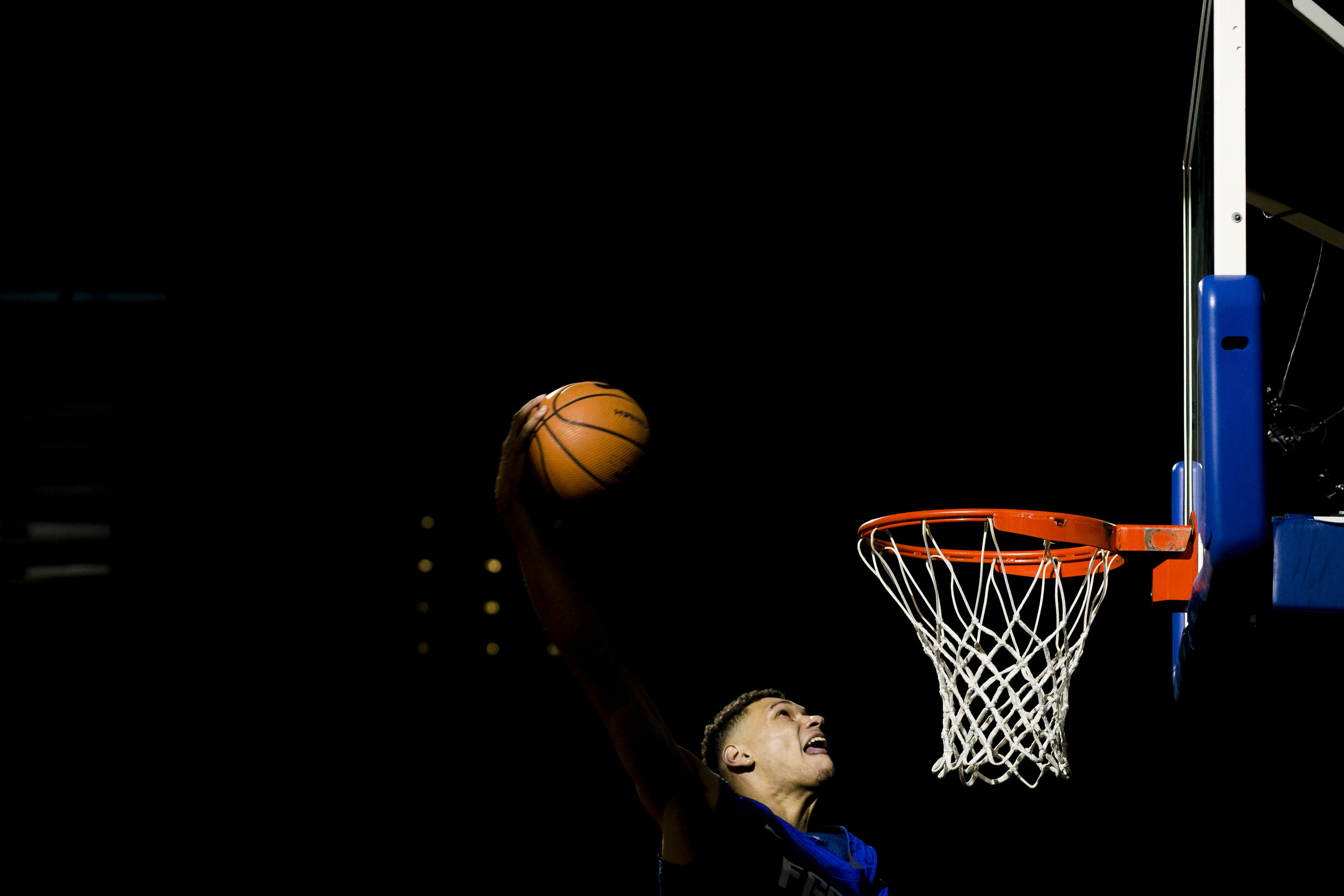 FGCU men's basketball forward Michael Gilmore slams one home in the dunk contest as the FGCU men's and women's basketball programs kicked off their 2017-18 campaigns with their annual pep rally, Dunk City After Dark, at Alico Arena Thursday, October 26, 2017 in Fort Myers.