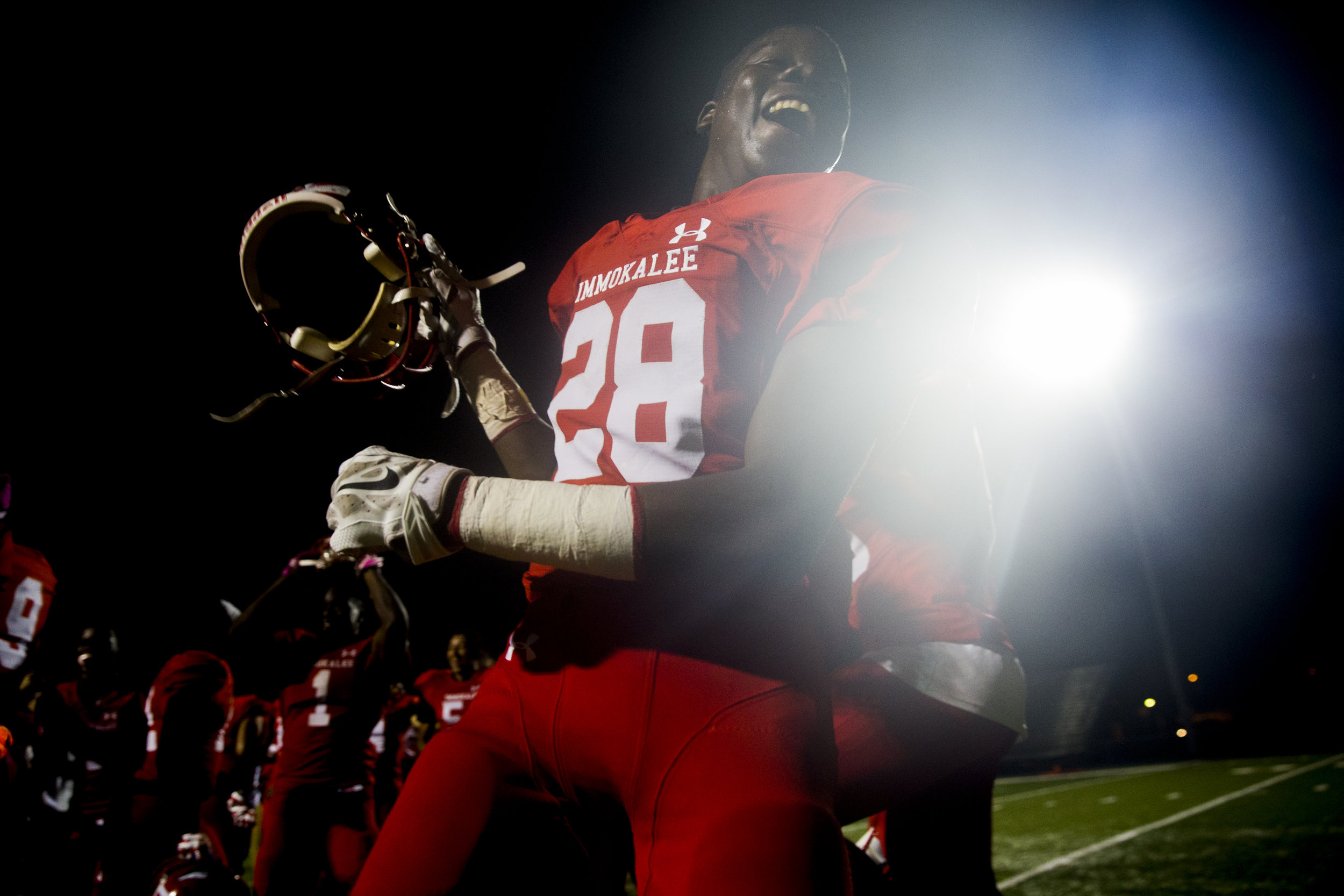 After defeating district rival Dunbar in a tightly contested matchup 30-23 Immokalee's Nevertesonne Lahens (28) and the rest of the team rush the field in celebration Tuesday, October 17, 2017 in Immokalee, Fla.