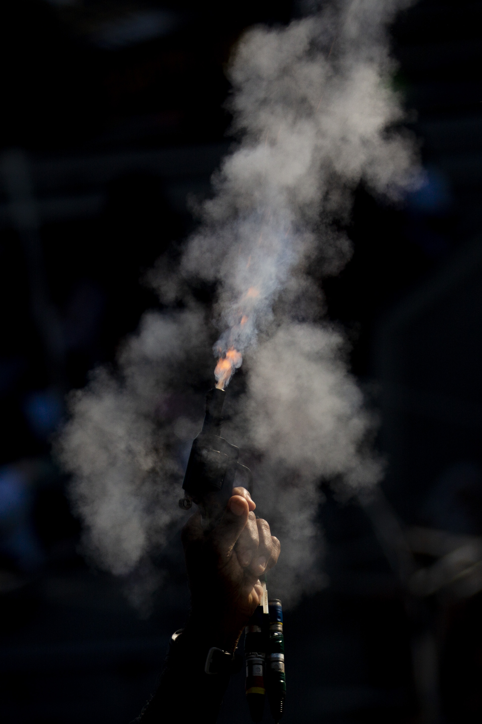 A starting gun is fired during the AAU Junior Olympic Games at Drake Stadium in Des Moines, Iowa August 2, 2018.