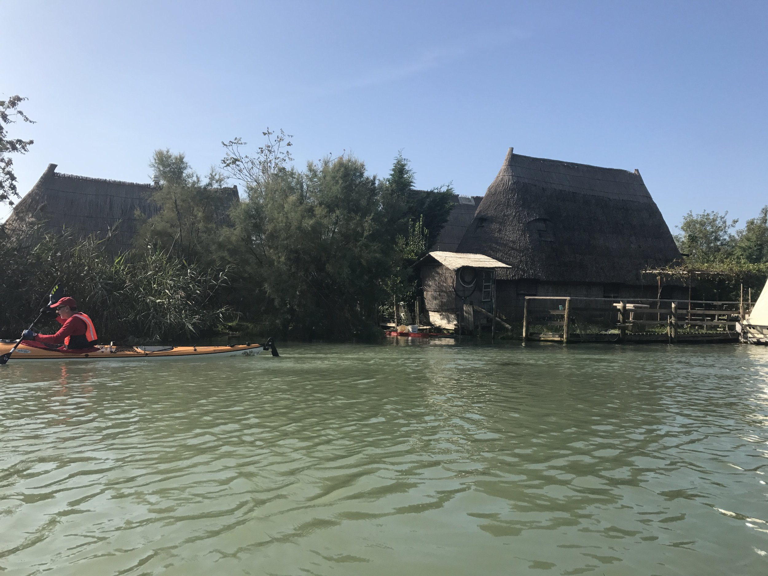Paddle silently beside some interesting thatched structures on our way through  Caorla Veneto.