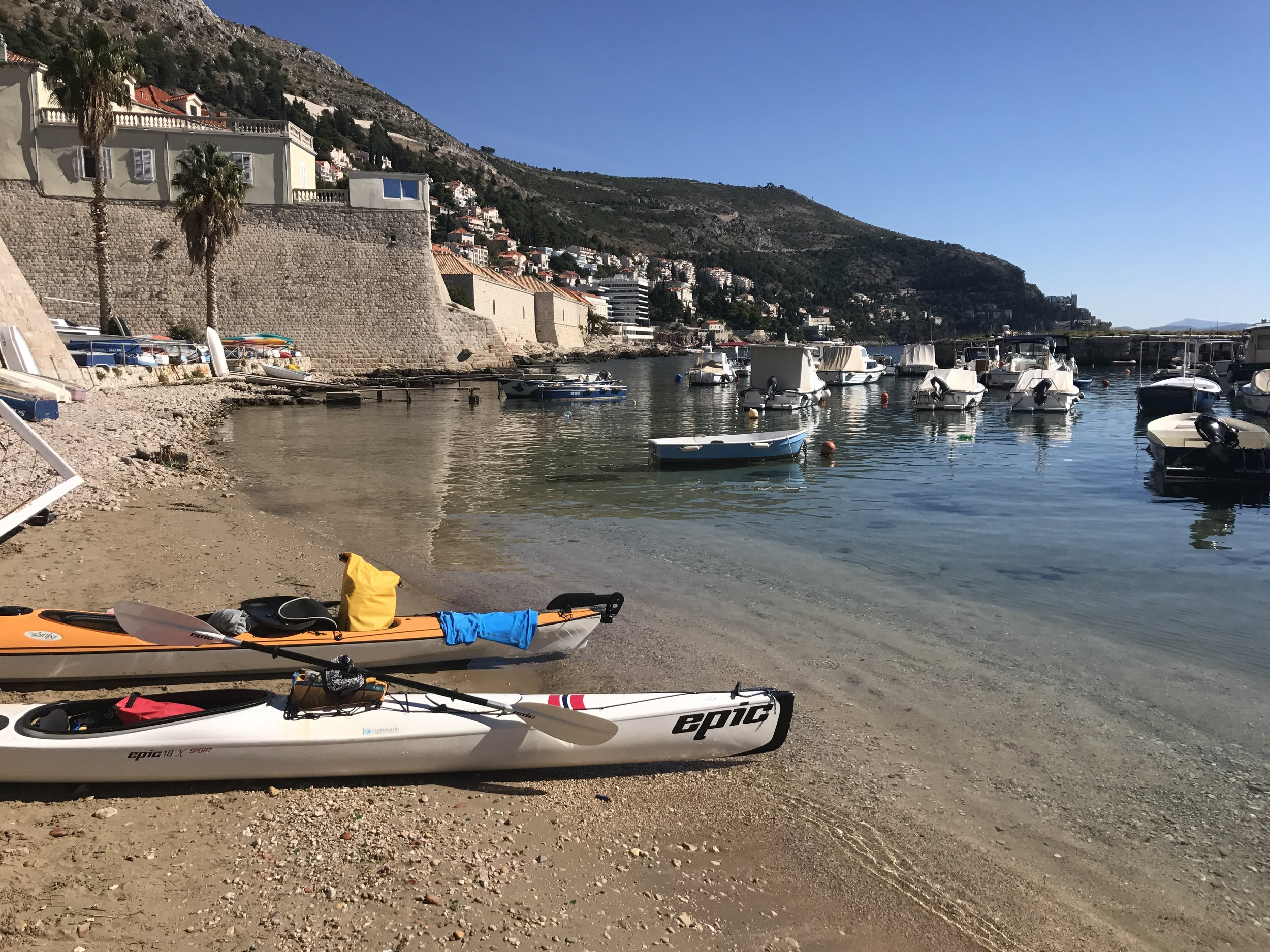 We find a place to park our kayaks. No problem.