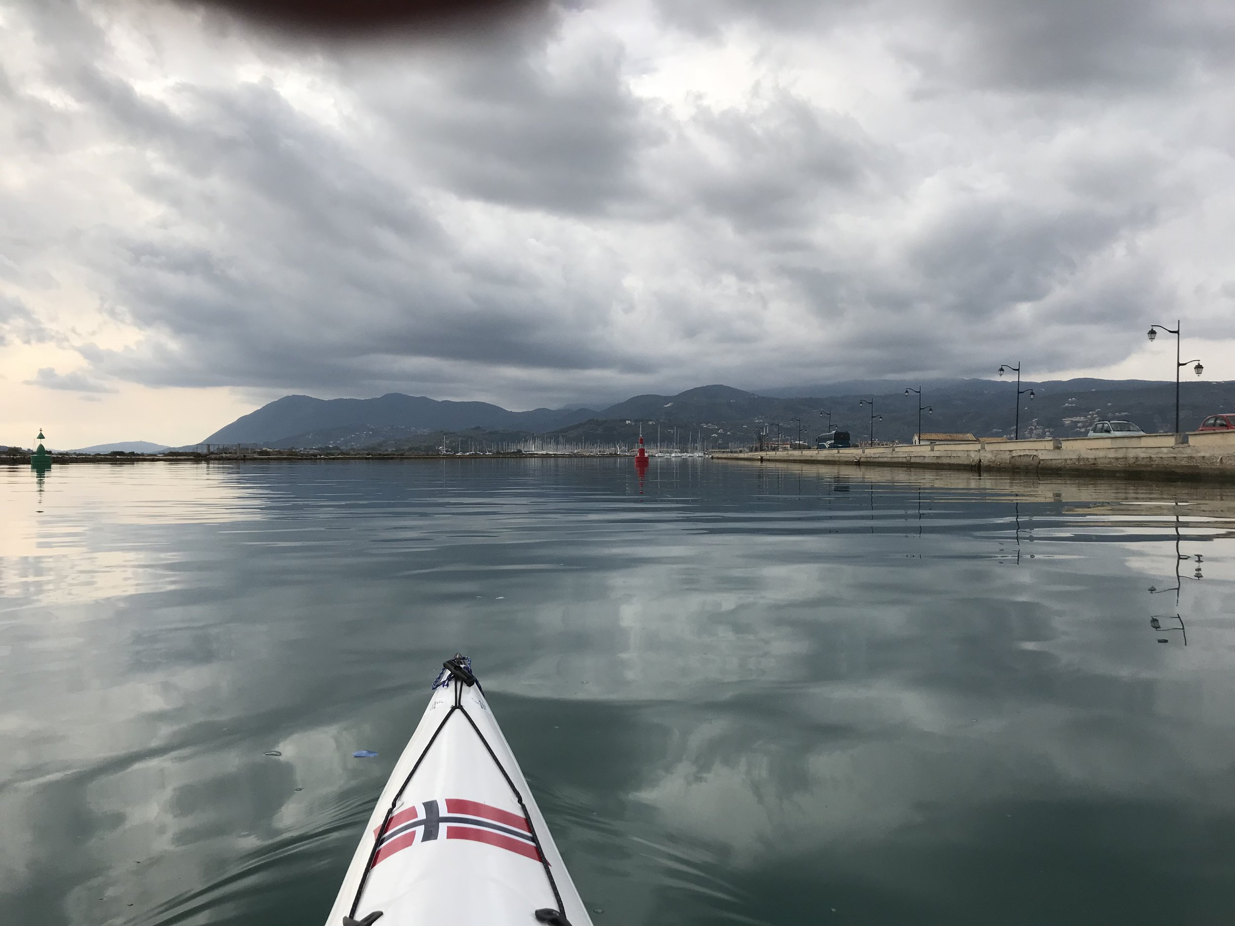 I breathe a small sigh of relief as I paddle quietly through a small passage into the heart of Lefkada. Grey clouds approach rapidly.