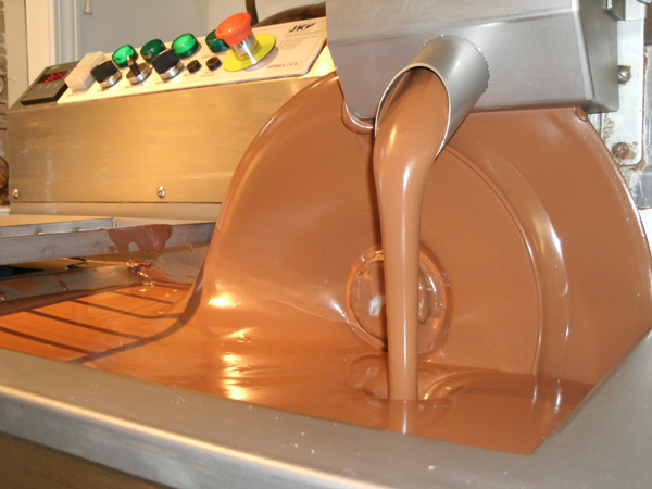 Tempering milk chocolate to get ready to make truffles.
