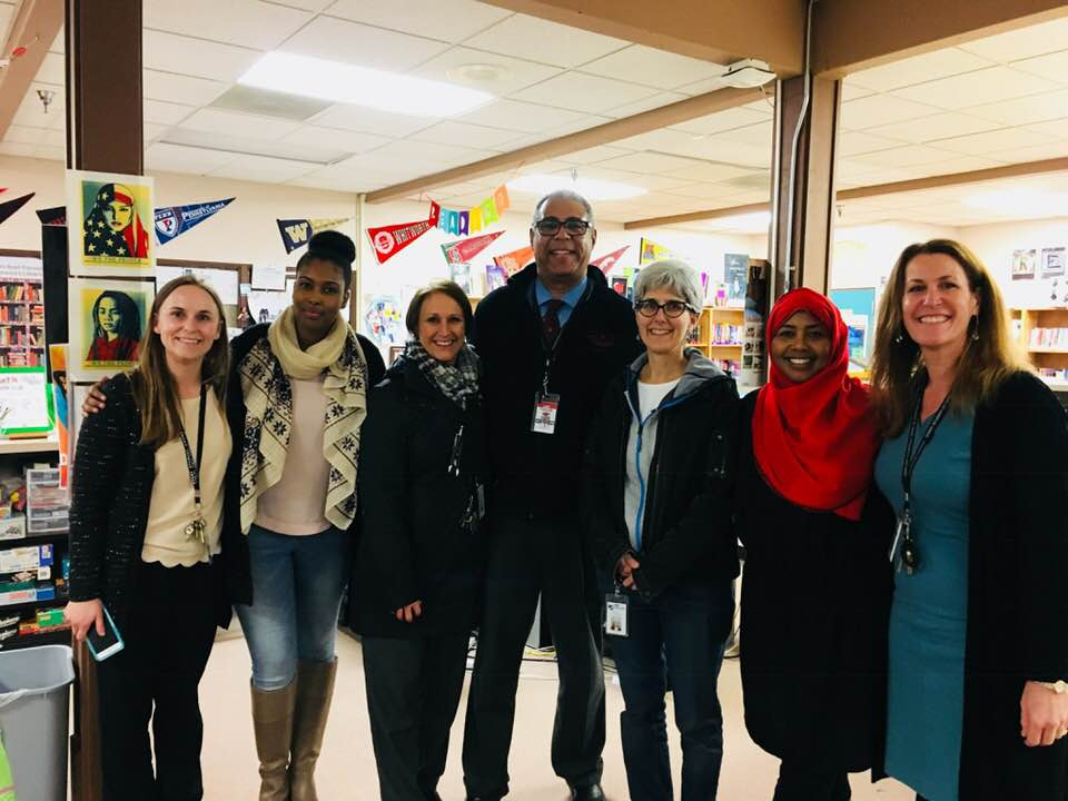 Principle Karin Jones and Faculty members of Chinook Middle School with Fathia and Ilays