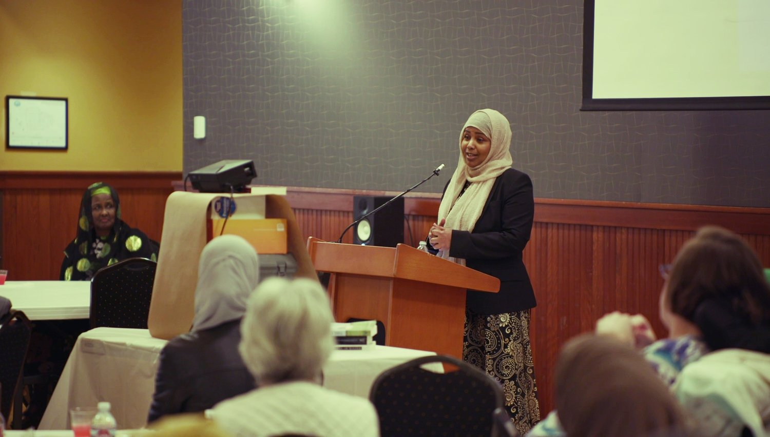 Fathia Absie addressing the guests at Eat With Muslims Anniversary Dinner April 27, 2018