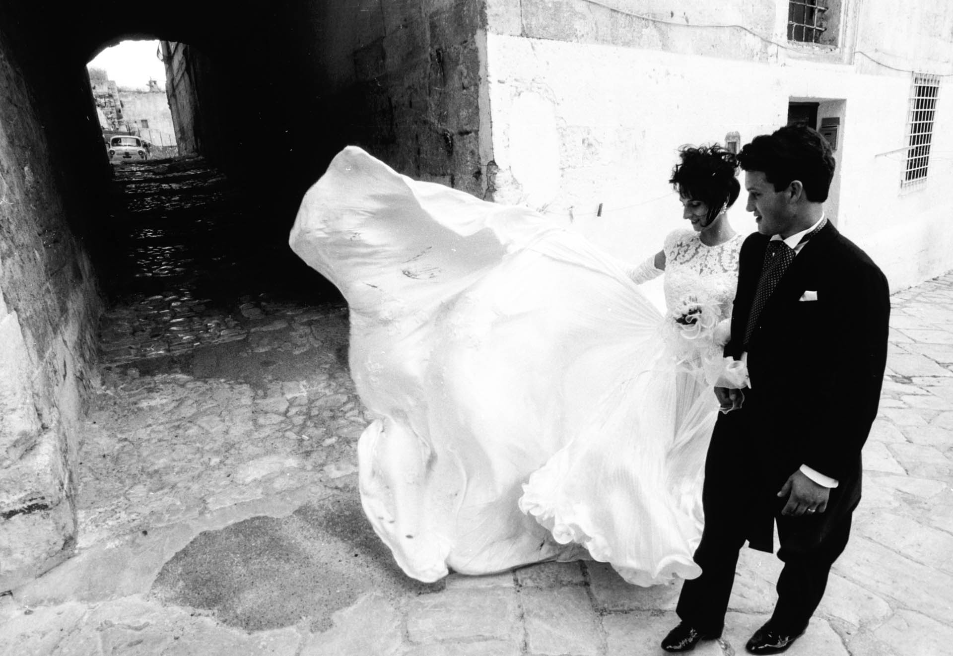 Matera, Italy - 19 October 1991 Immediately after the wedding ceremony, it's a local tradition for the couple to walk alone along the town streets.