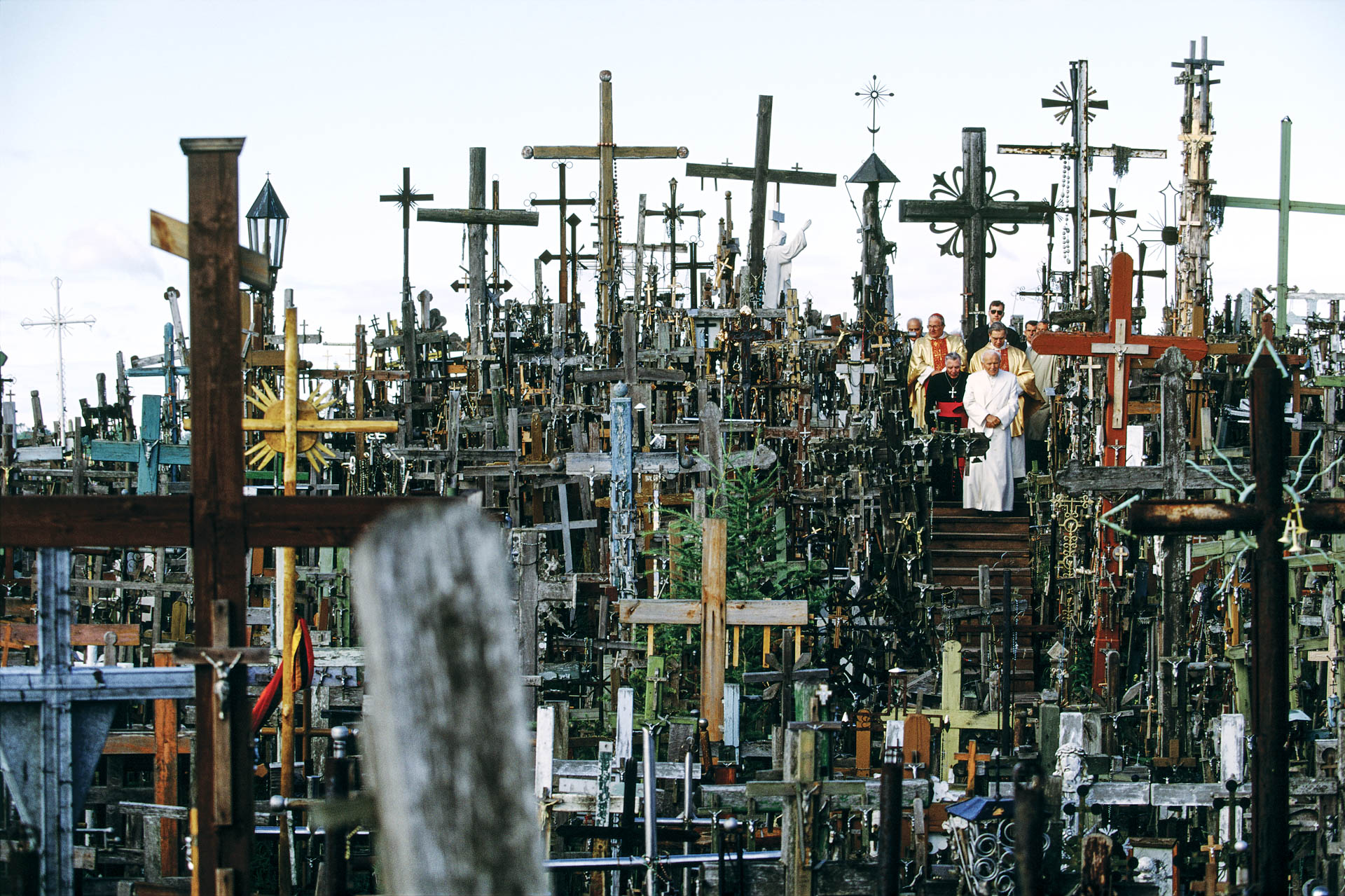 "Lithuania - September 1993 ""To commemorate the sons and the daughters of your land, those who were tried, those who were imprisoned,sent to concentration camps, deported to Siberia, condemned to death. ""Although partially destroyed several times, the Hill of Crosses has always been rebuilt."