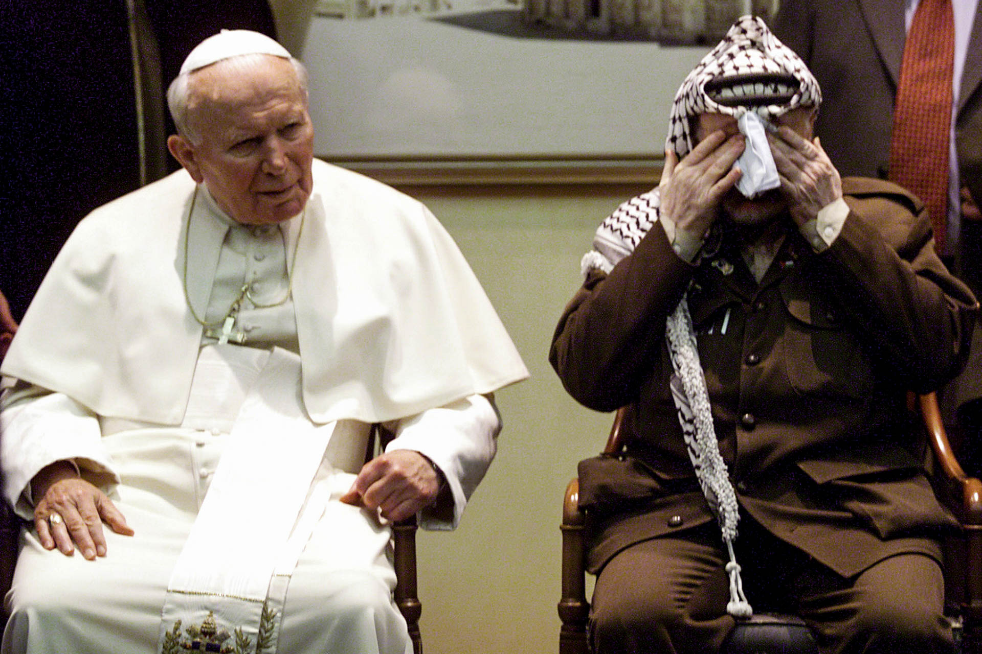 Bethlehem, Palestine - 22 March 2000 Pope John Paul II and President Yasser Arafat during welcome ceremony in the Presidential Palace .