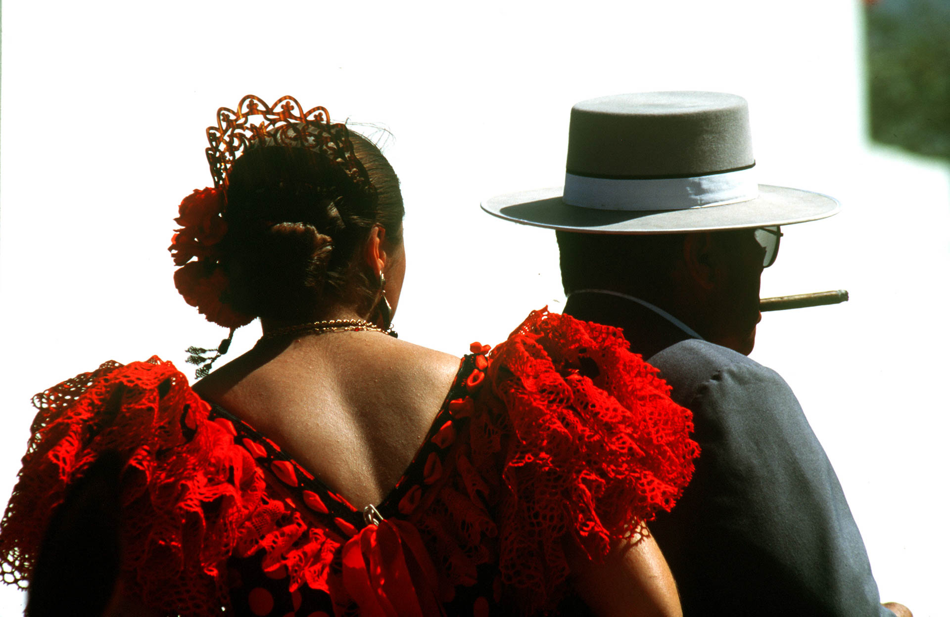 The miracle around the world: El Rocio, a couple on horseback wearing traditional costumes of Sevilla.