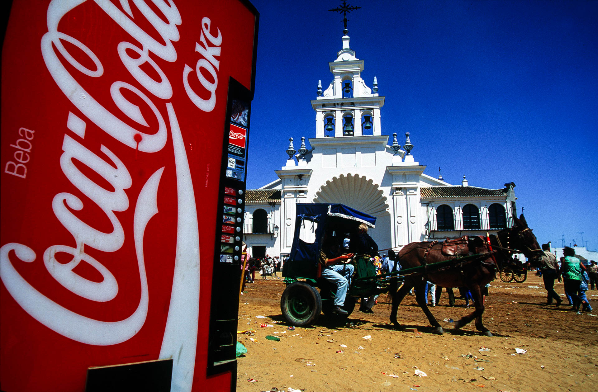The miracle around the world: El Rocio, a Coca-Cola distributer in front of the sanctuary.