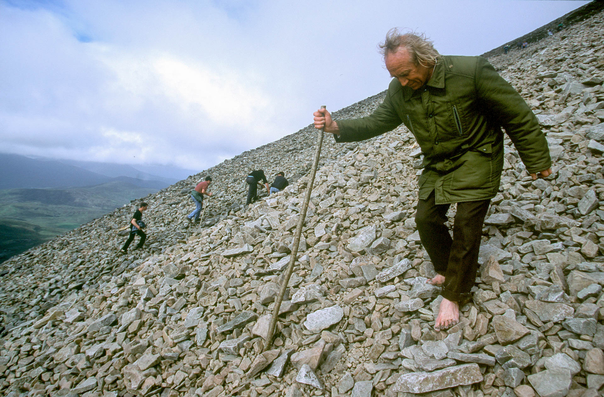 The miracle around the world: Ireland, an elderly man descending the Patrick Croagh.