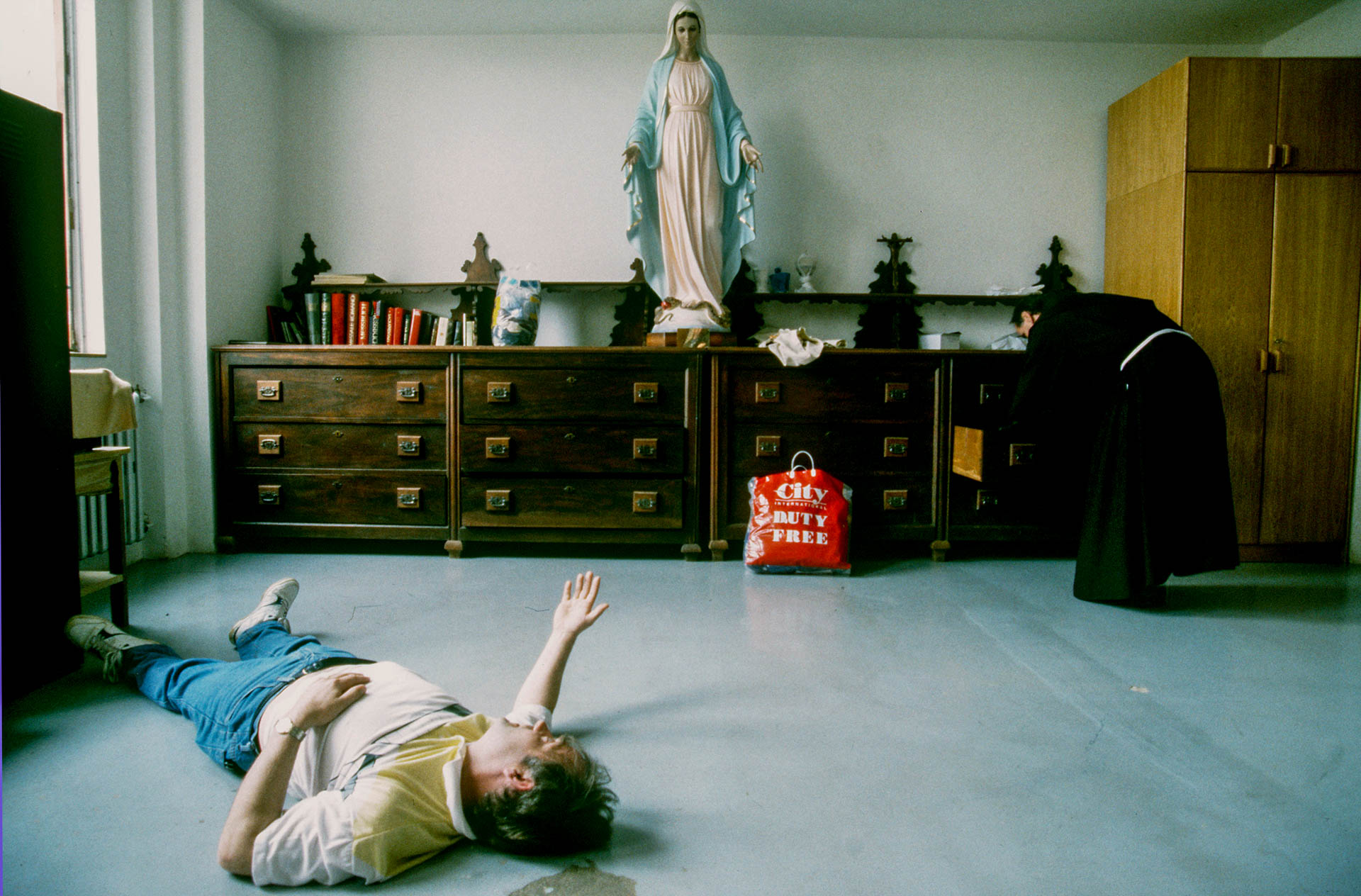The miracle around the world: a believer just after an exorcism by Father Jozo in the Sacristy of the monastery.