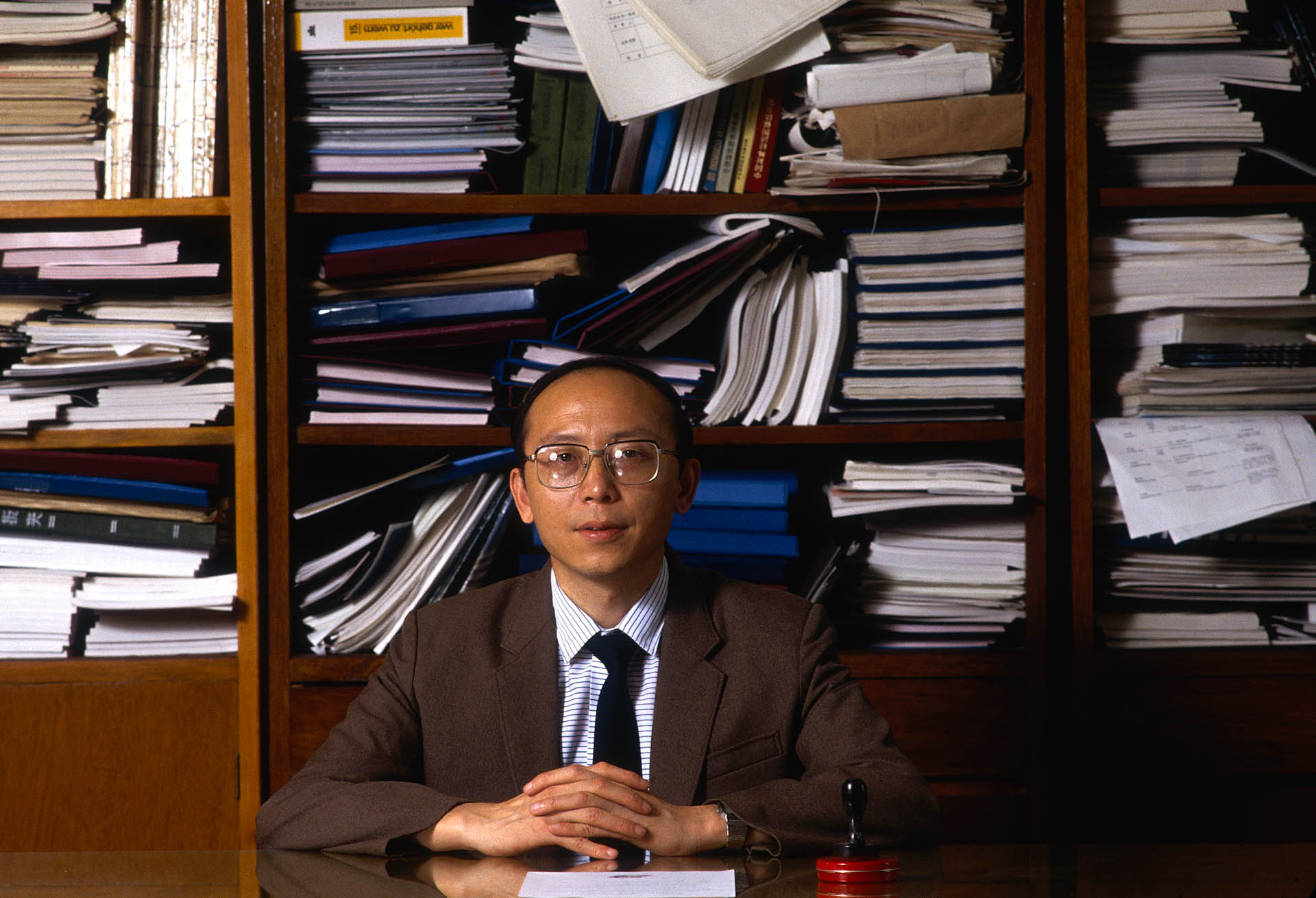 Shanghai, China - June 1988. Ye Long Fei, director of the Shanghai Foreign Investment Corporation. He is the only one taking the decisions regarding the city economic plan.