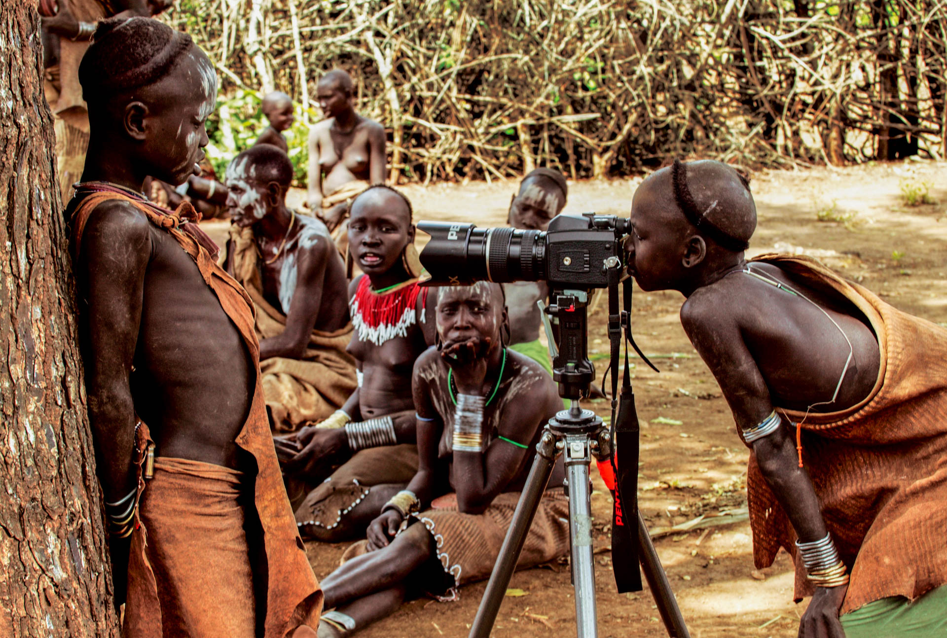 The Mursi are very curious: this child can't resist the temptation of looking through the camera.