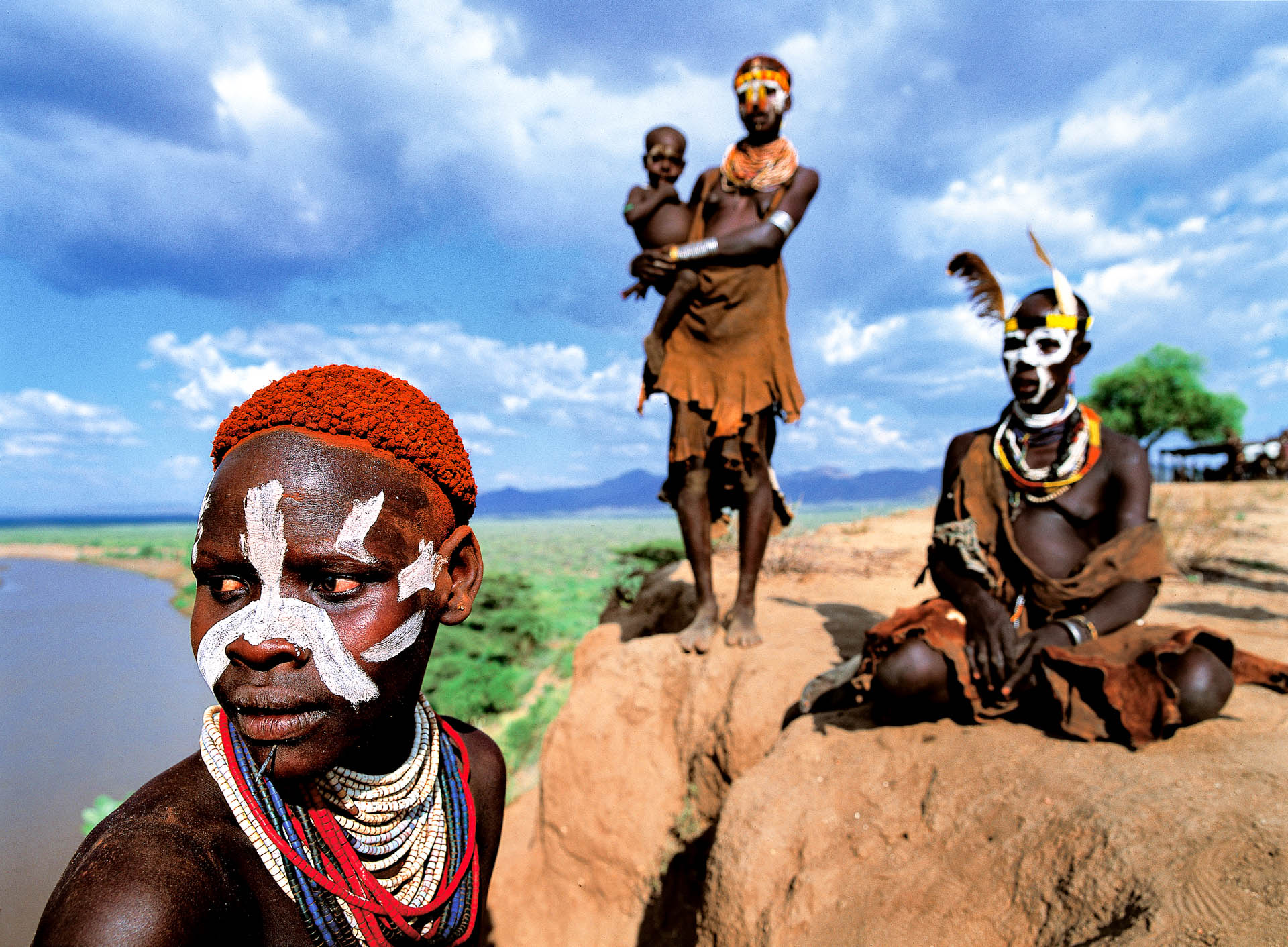 A group of women standing on the promontory close to their village.