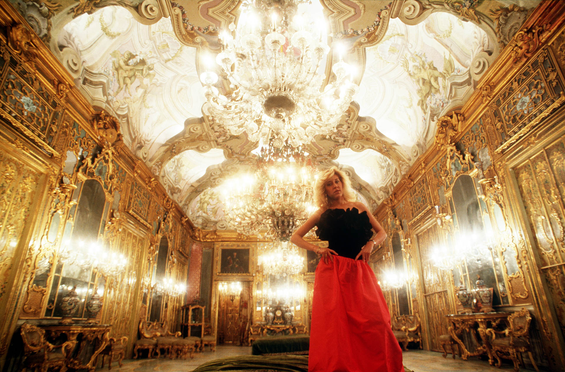 """Palermo, Italy - 11 December 1987 Stefanella Vanni Calvello di S. Vincenzo portrayed in the family's residence, Palazzo Gangi, in Palermo where Luchino Visconti filmed the scene of the ball of """"Il Gattopardo"""".© GIANNI GIANSANTI"""