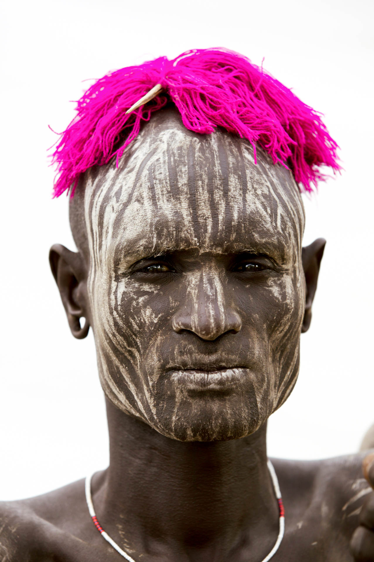 Omo Valley, Ethiopia - June 2003African Beauty: portrait of people of Mursi tribe from Komba village, in the Omo Valley.© GIANNI GIANSANTI