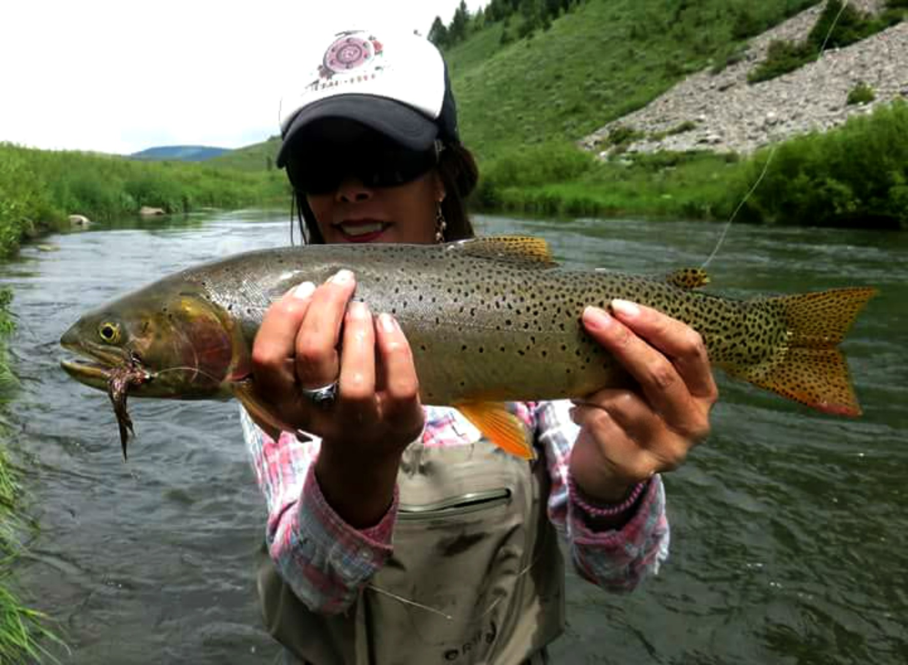 Verlicia (Lisa) Perez  As a mother of 4 and grandmother to 4, I am a true believer in exposing children to the true essence of nature and all that it entails. Fly fishing has been such a beautifully healing experience for me; one that I cannot wait to share with my mentees. To allow them to experience all that is fly fishing....beautiful loops of colored line passing above pristine waters; anglers hip deep in a mountain stream while clouds of caddis flutter in the adjoining bushes; or a thick shouldered cutthroat held half out of the water while a smiling angler reaches down to unpin a perfectly chosen streamer from its lower jaw, is what I look forward to experiencing with our foster kids and fellow mentors alike.    I believe each angler's fly fishing journey takes on a form of spirituality. I believe everyone has a right to take their spiritual journey in the manner they see fit. Be it in a library studying the teachings of a philosopher, on a mountain top in Tibet learning from a master, or on the sides of a river in Utah learning from nature, the choice is an individual one. For me, I think I prefer to attend the church of the Logan, Blackfoot or the Salmon. With luck, someday I will become a true angler, and not just a fish catcher.