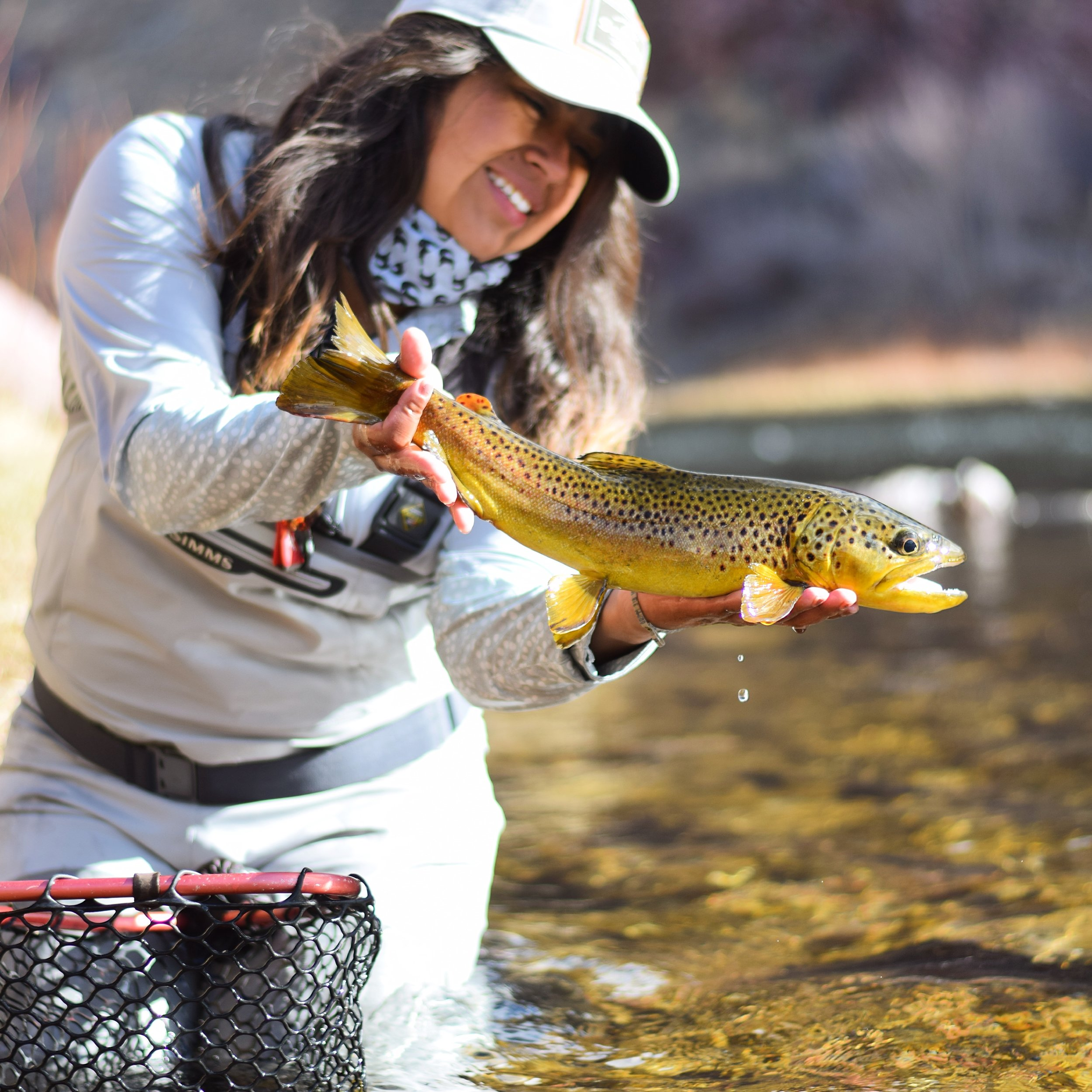 """Rebeca Granillo  Rebeca is a Utah Fly Fishing Guide and founder of the Wasatch Women's Fly Fishing Club. Rebeca's passion for teaching, studying and sharing her love for the sport can often be reflected in her volunteer work. She has been on the Utah Casting for Recovery team, an instructor for the High Country Fly Fishers Women's Clinics, Workshop volunteer at the Wasatch Expo On-Stream Classes and now, she is honored to dedicate her time towards the The Mayfly Project.    """"In fly fishing, we have the opportunity to become astray. Astray from our difficulties, our day to day challenges and sometimes, our greatest fears. That sense of feeling lost from the things that cloud our minds often gives us the opportunity to step back, observe our surroundings and find positive direction. If I can share that with an individual who might benefit from such an experience, I will take the opportunity. And I believe that this is one of those opportunities. I wholeheartedly look forward to being a Mayfly Project Mentor for our local foster kids. I have a feeling that this sport will heal their hearts and shape their futures into the brightest of ways."""" - Rebeca Granillo"""