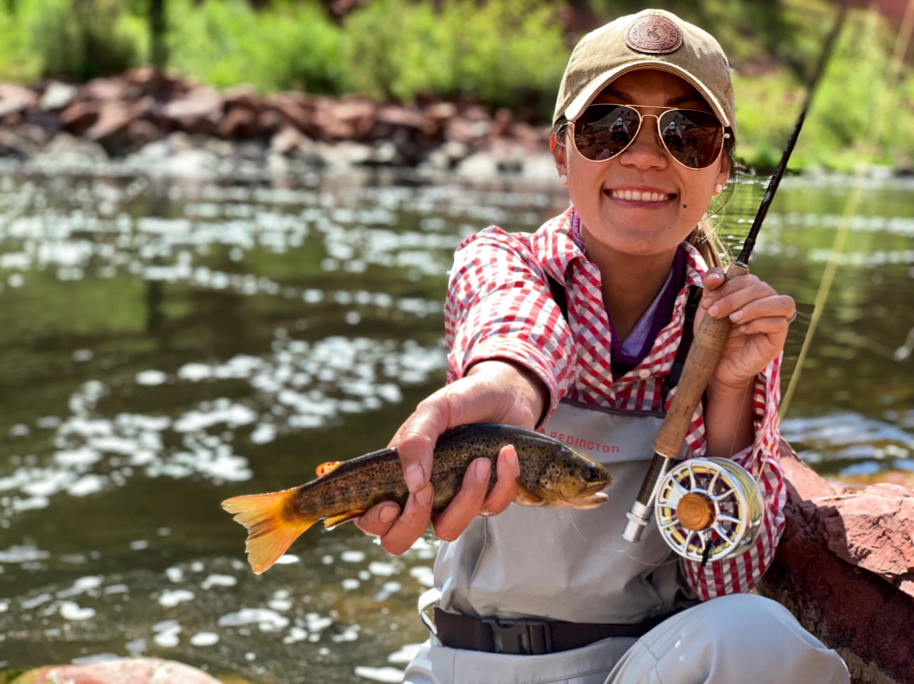 Lisa Le  Lisa is an Oklahoma native and grew up spinning rod fishing. It wasn't until her move to Colorado did she pick up fly fishing. She became obsessed from the very moment she picked up a fly rod. She is a pediatric echocardiographer and finds joy in taking care of the pediatric population. She has fished all over Colorado, but especially loves fishing in high alpine lakes or rivers. Her favorite catches are cutthroat and brown trouts. She loves being outdoors and you can find her on the water with her husband and bernedoodle-Traveler. Fly fishing brings peace and serenity to her psyche and she is looking forward to sharing her passion for sport and nature with the younger generation.