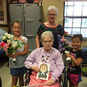 Lynda Martinez, her granddaughters and Flat Wesley went to Silver Tree to deliver flowers to the residences.