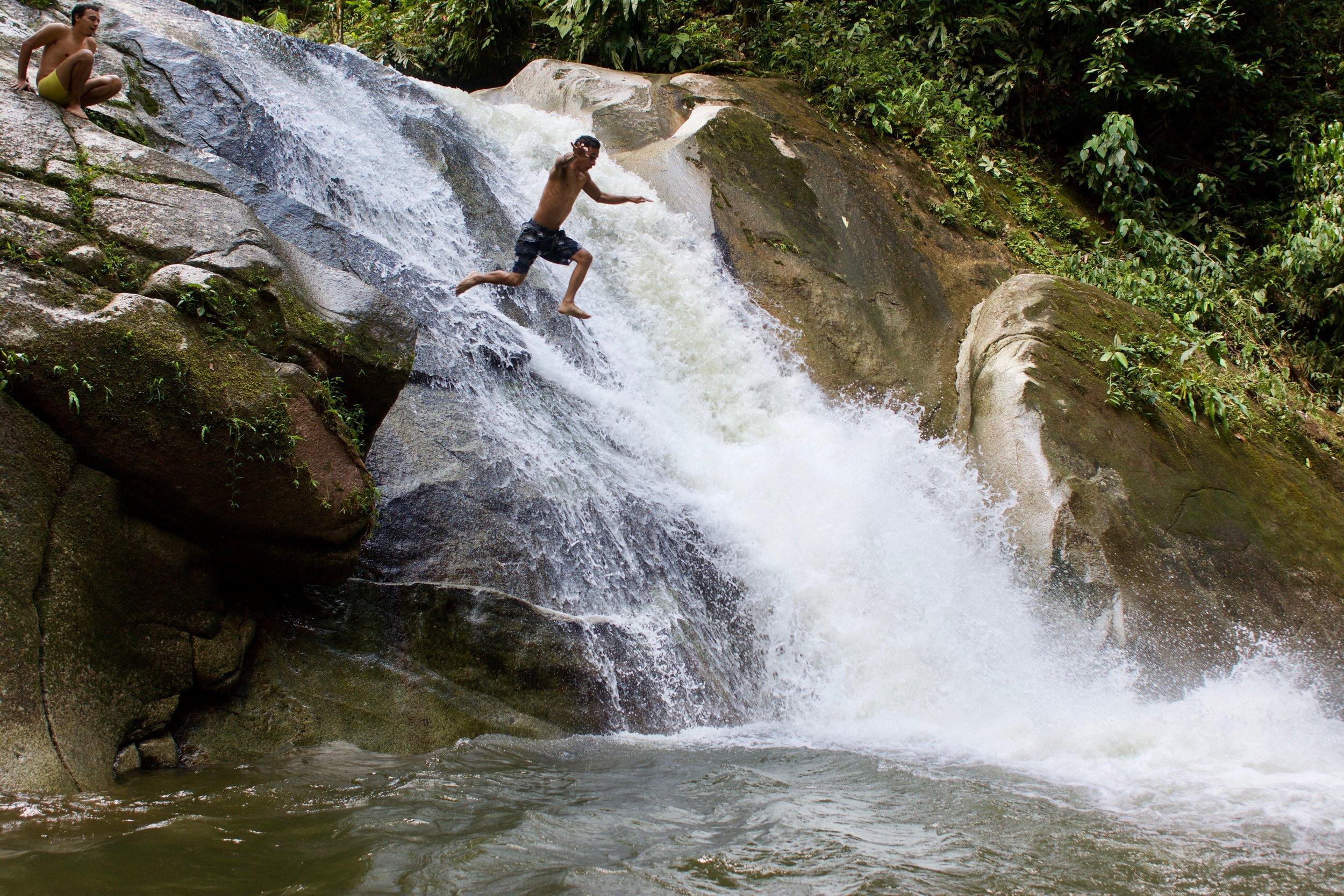 Daniel jumping off a waterfall