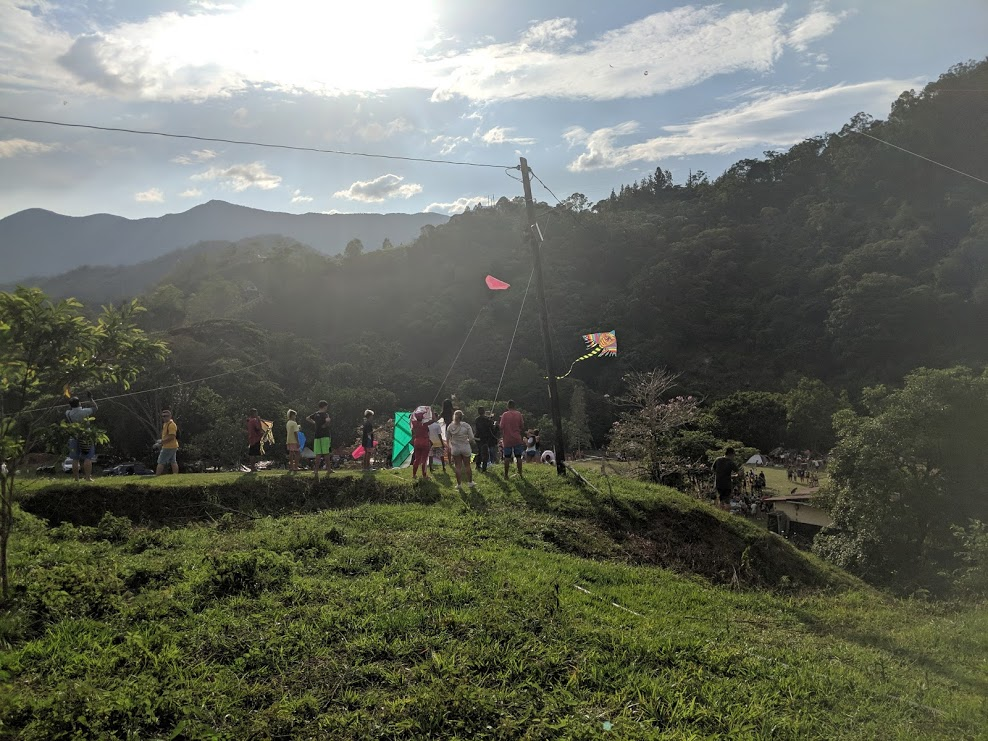 San Carlitanos and Water Party-goers gather atop a hilltop at  La Planta  to fly kites during  Las Fiestas del Agua .