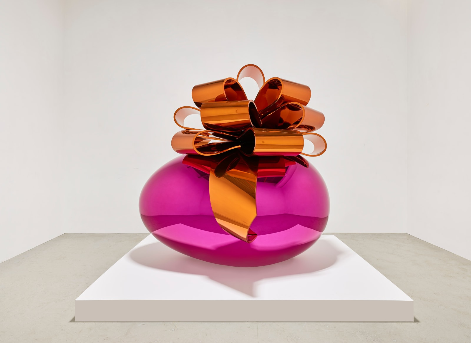 #8 Jeff Koons   Smooth Egg with Bow (Magenta/Orange)  (1994–2009)  Mirror-polished stainless steel with transparent color coating  Exhibited at Edward Tyler Nahem Fine Art's booth (Art Basel in Miami Beach)