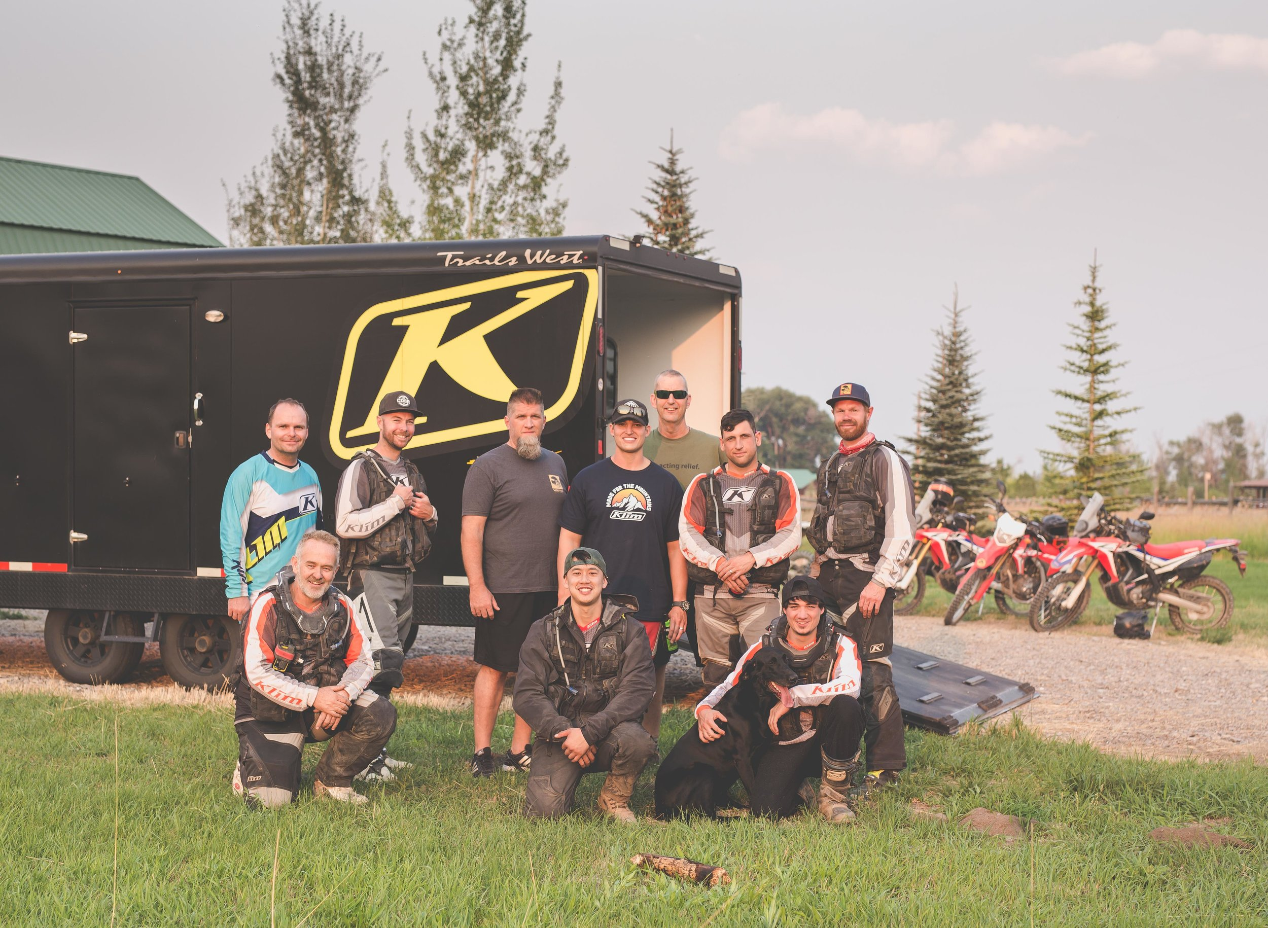 Group Photo with the council members of the  2017 KLiM Dual Sport Summit.   Top:   Stephen Clark   ,    Matt Negrete   ,    Richard Hughes   ,    Corey Lofton   ,    Mark Kincart   ,    Spencer Hill   ,    Nick Livingston   .   Bottom:   Simon Cudby   ,    Kin Creible   , Annabelle, Myself.   Photo by   Simon Cudby   of   Upshift Online   ,  edited by     Nick Livingston   .