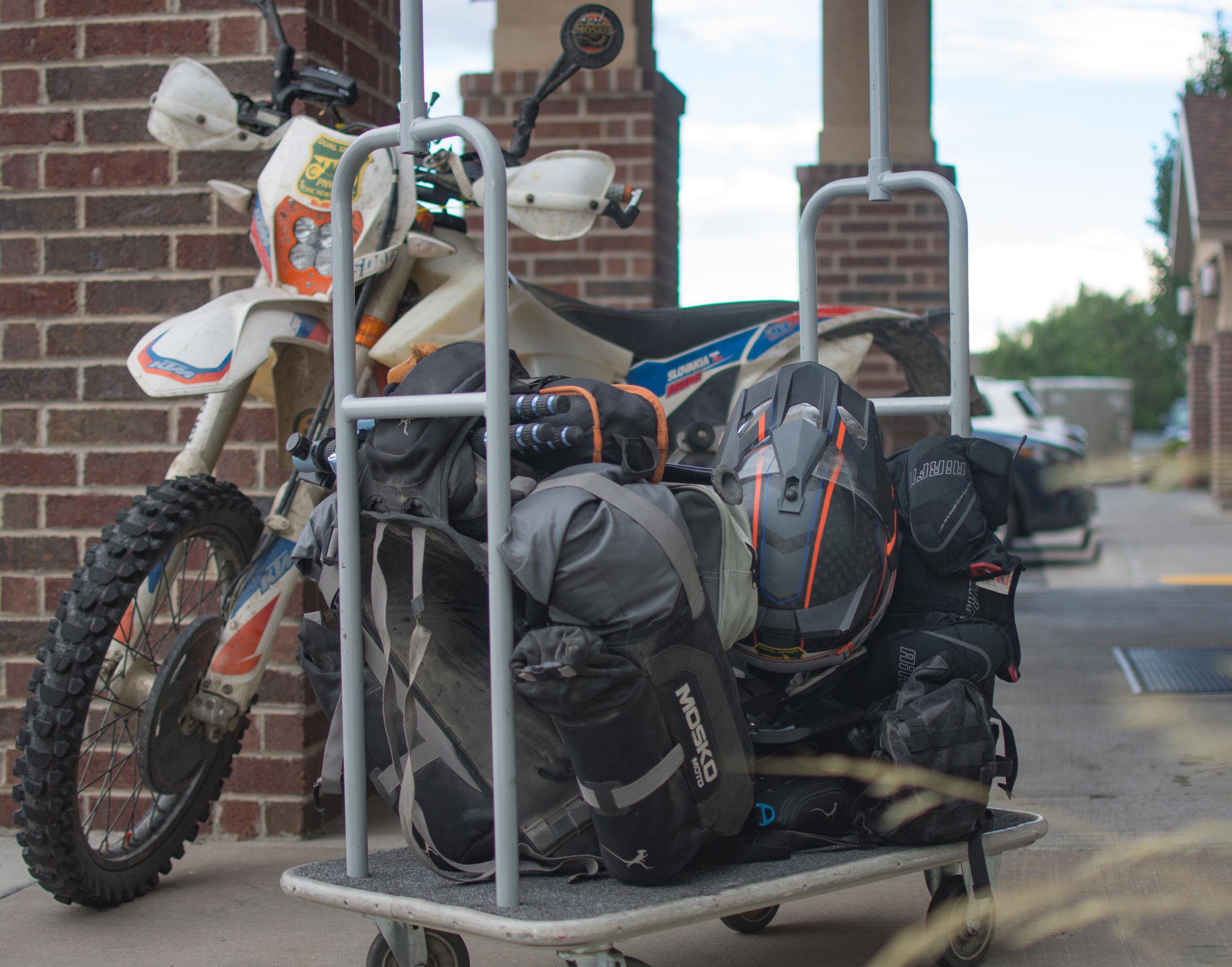 Loading a fulll cart on a dirt bike.
