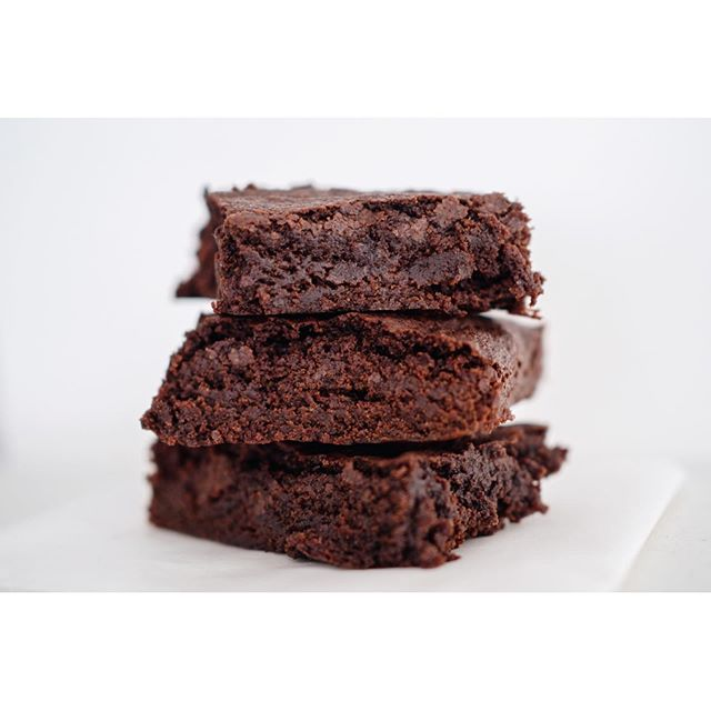 "The yummiest fudgy brownies everrrr! These were the first things I made when we moved to Halifax because I had oodles of cocoa powder (?!) and no baking chocolate. This brownie recipe calls for cocoa powder only, so it was perfect and now it's saved as my (and 👱🏼‍♂️'s) favourite brownie recipe! 🍫 . . . . It's by @lovefromtheoven and it's called ""easy brownies made with cocoa powder"" if you want to google it. I also melt the butter in the microwave and stir everything in by hand after rather than use a double boiler."