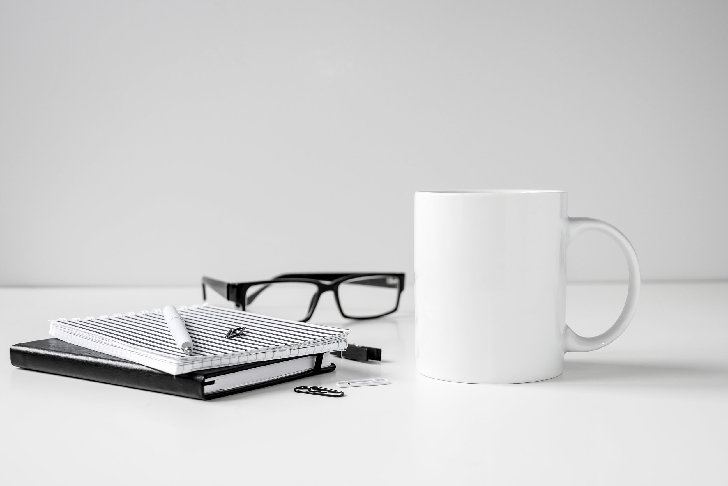 "Figure 1.  From ""Black and white coffee mug mock up with notebooks, pen and glasses on work desk,"" by Sigridstock, n.d.,  https://www.shutterstock.com/image-photo/black-white-coffee-mug-mock-notebooks-724222396/ . Copyright 2018 by Sigridstock."