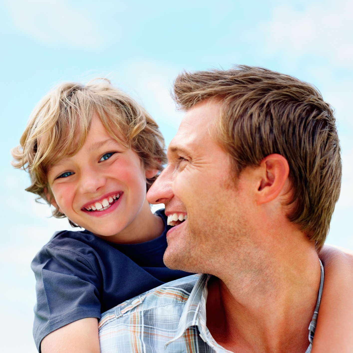 Cheerful-mature-man-carrying-his-son-on-back-157685733_2122x1415.jpeg