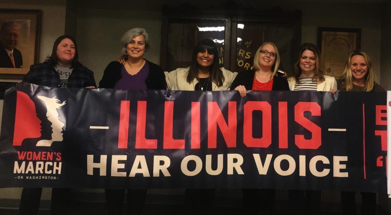From left to right: Brandi Stark (Peoria), Co-Chair Amanda Drenth, Co-Chair Mrinalini Chakraborty, Liz Hunter (Carbondale), Jennifer Lee (Springfield), Jane Scudder - Operations. Not Pictured: Vikkie Cossio (Bloomington/Normal), Chelsea Rennert (Champaign/Urbana)
