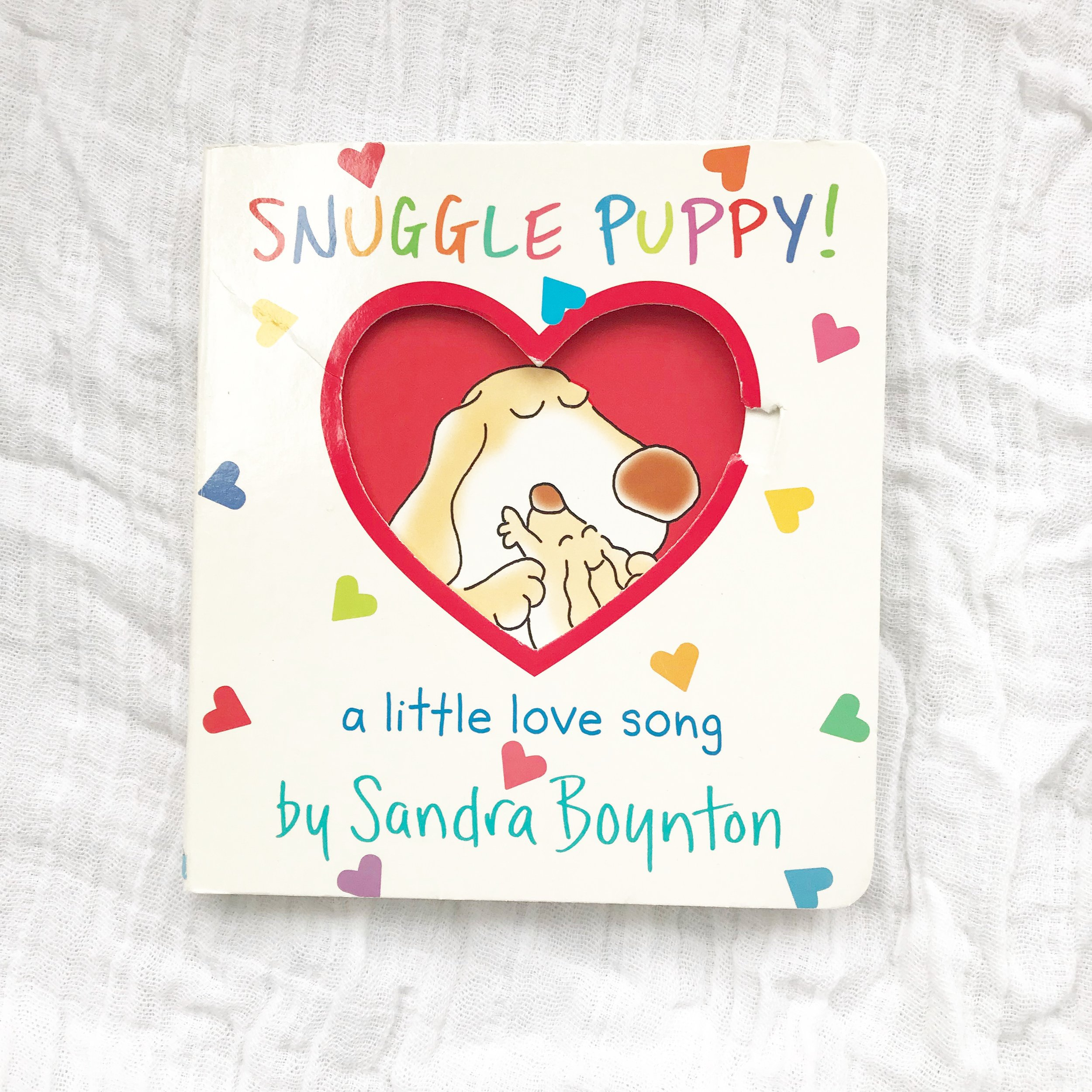 Snuggle Puppy   My kids love Sandra Boynton books - this one is just as silly and playful.  Skip this one if you don't like singing ridiculous songs.