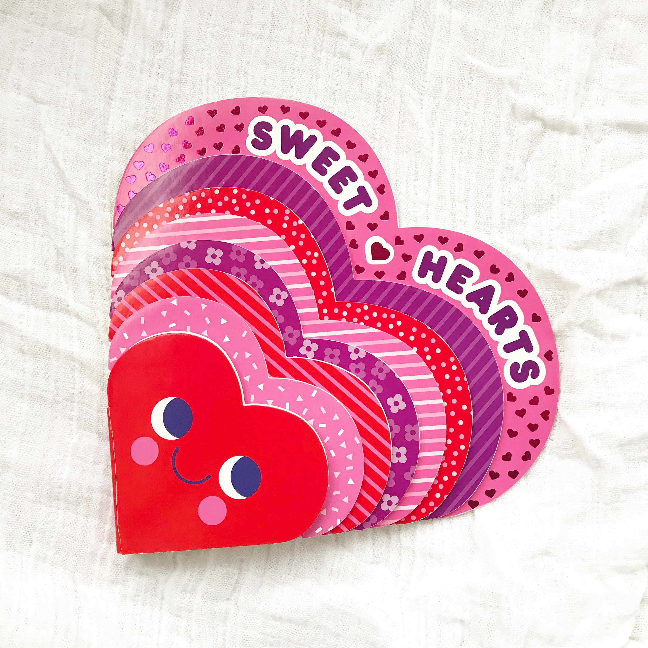 Sweet Hearts    Teaches our little ones in the sweetest way that the more love you give,  the more love you have. Also, how cute is this heart shaped book?  Perfect for your little Valentine.