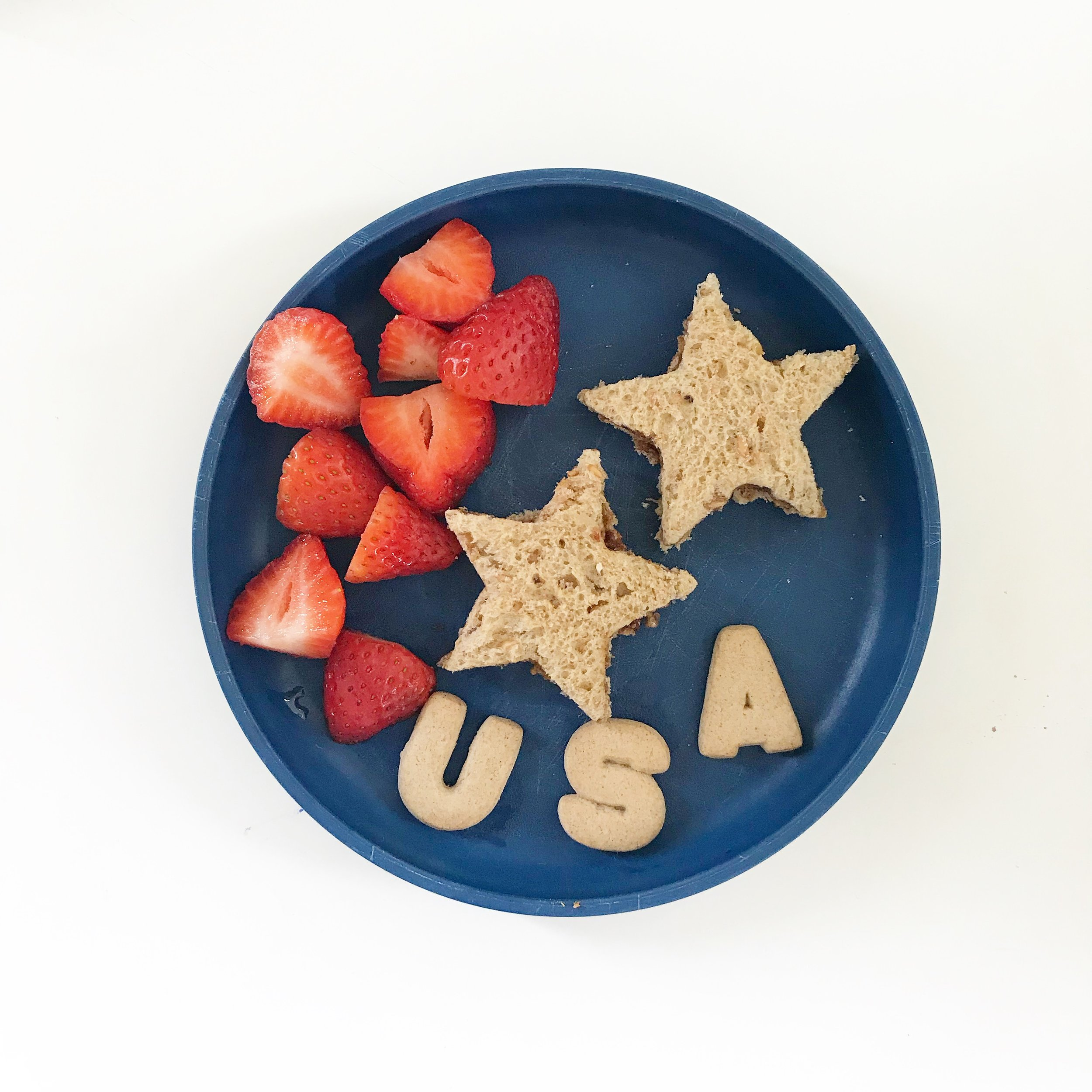 Fun shaped sandwiches can make a picky eater go mmmm.  We put  Better Almond Butter  + honey + chia in our Star Sandwiches  (buy the cookie cutters we used  HERE  for $3.99)  Side of Strawberries  Letter cookies for USA