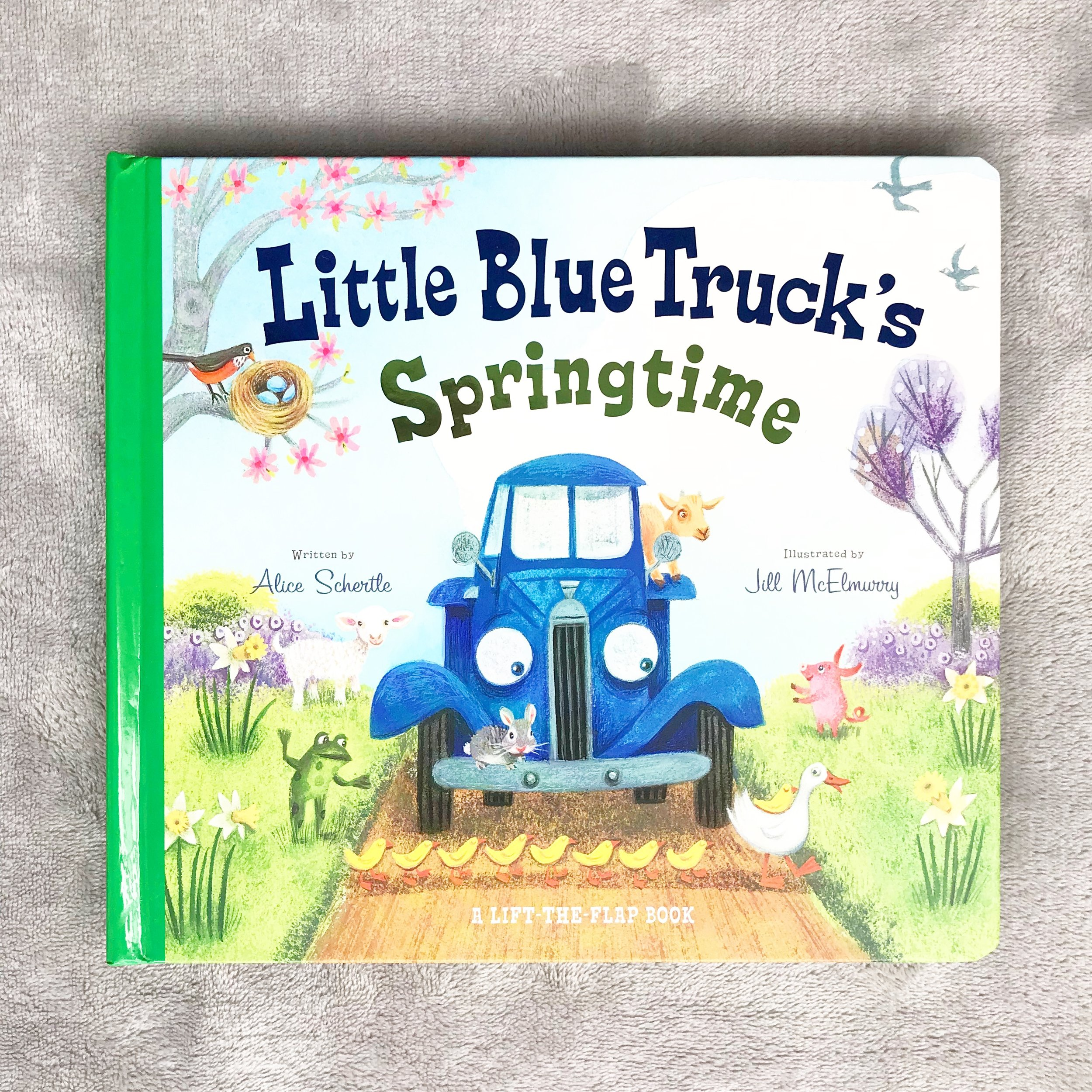 Little Blue Truck's Springtime   We were on a roll of finding our favorite series books but in the spring time version.  This one is full of baby farm animals and flap pages.