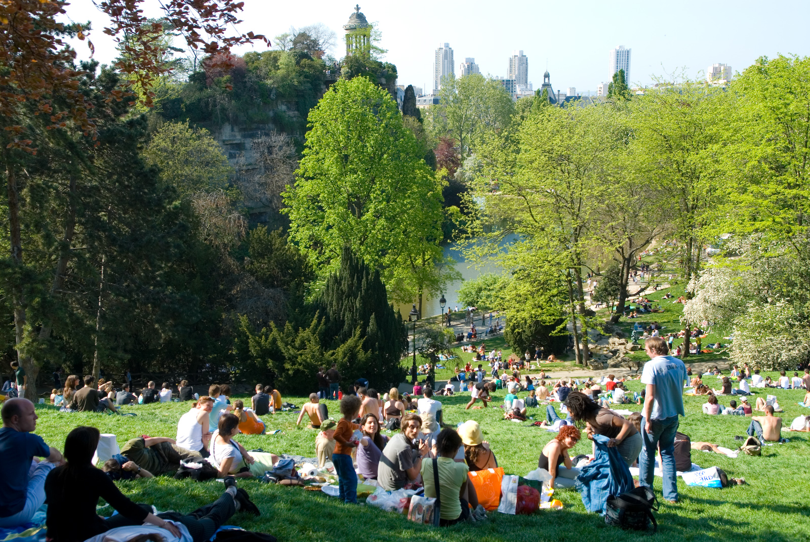 Parc des Buttes-Chaumont - The Parc des Buttes-Chaumont is so cool because it doesn't feel touristy at all. And it's enormous! This park has rolling hills, hiking trails, playgrounds and so many cute dogs to watch. 🐩🐕 Walk over the cool suspension bridge for a view of the whole park.