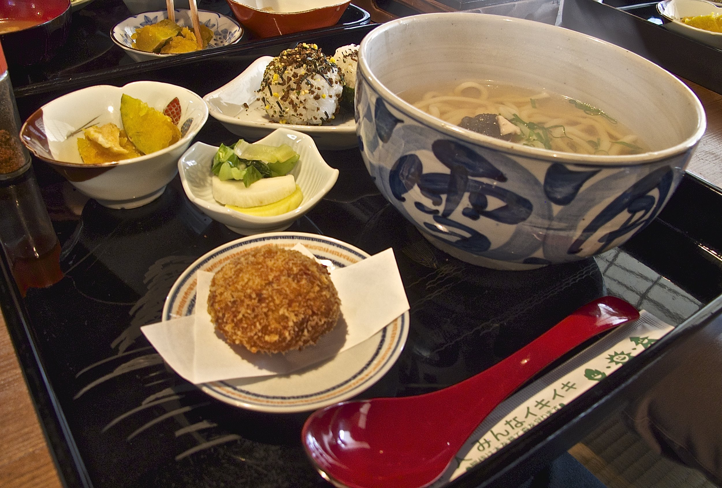 One of the winter lunch specials is hot udon noodle soup made with Mrs. Nishino's aged dashi broth. The restaurant's famous potato croquettes are served alongside every dish.